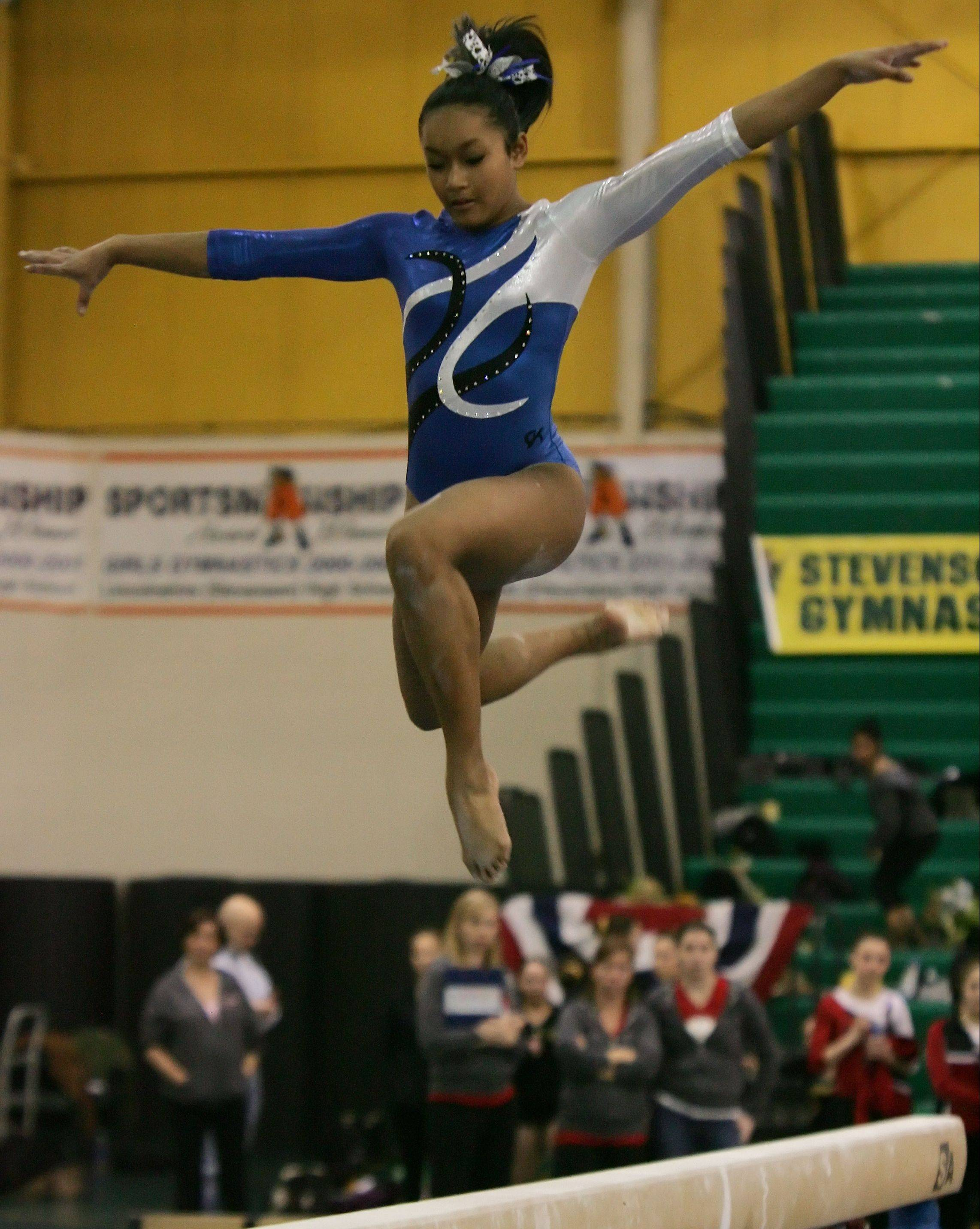 Vernon Hills' Alli Tran competes on balance beam during Thursday's sectional meet at Stevenson.