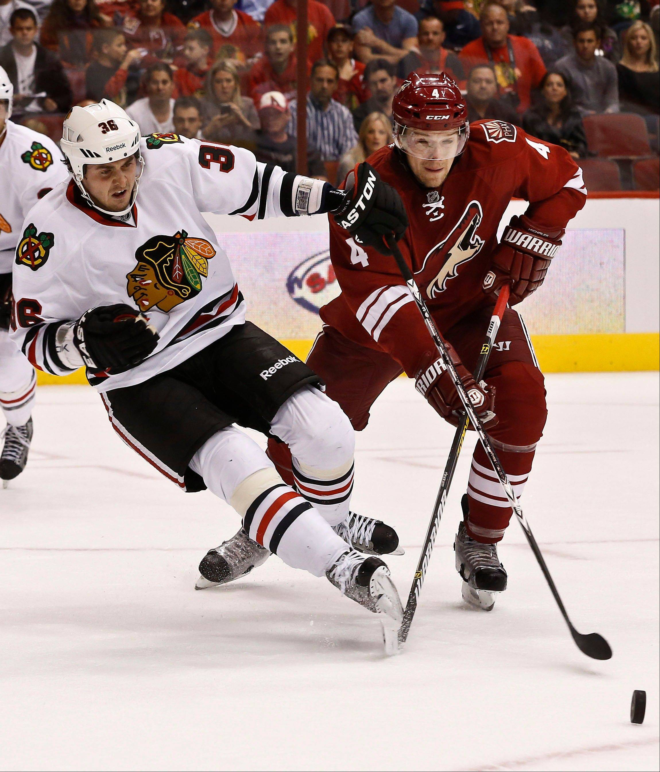 Phoenix Coyotes' Zbynek Michalek (4), of the Czech Republic, gets called for tripping on Chicago Blackhawks' Dave Bolland (36) during the first period in an NHL hockey game Thursday, Feb. 7, 2013, in Glendale, Ariz.