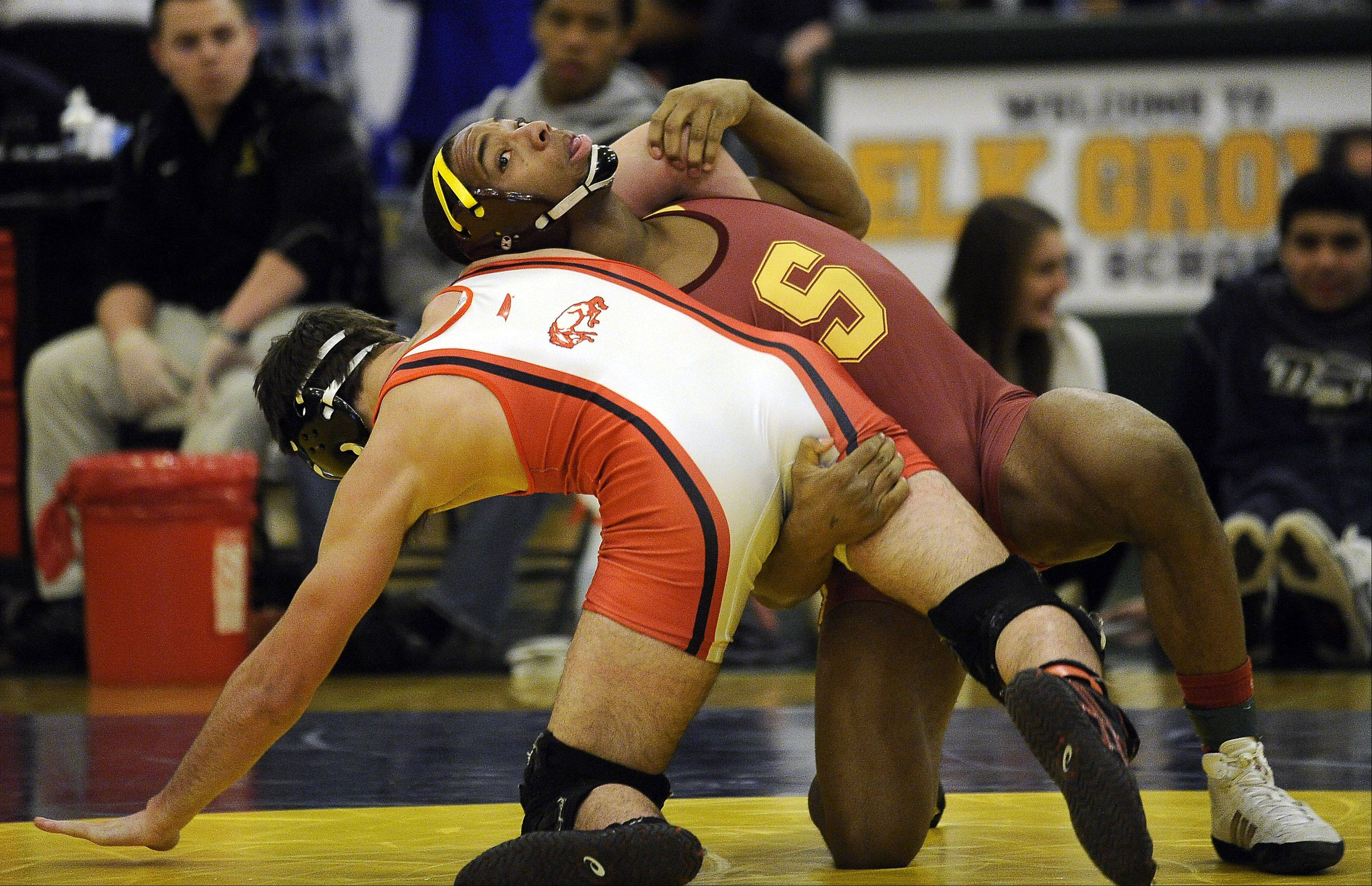 Schaumburg's Sadarriss Patterson, right, battles Barrington's Nick Shealy at 152 pounds in last year's MSL meet. Patterson was a regional champ at 160 last weekend and competes in the Maine East sectional this weekend.