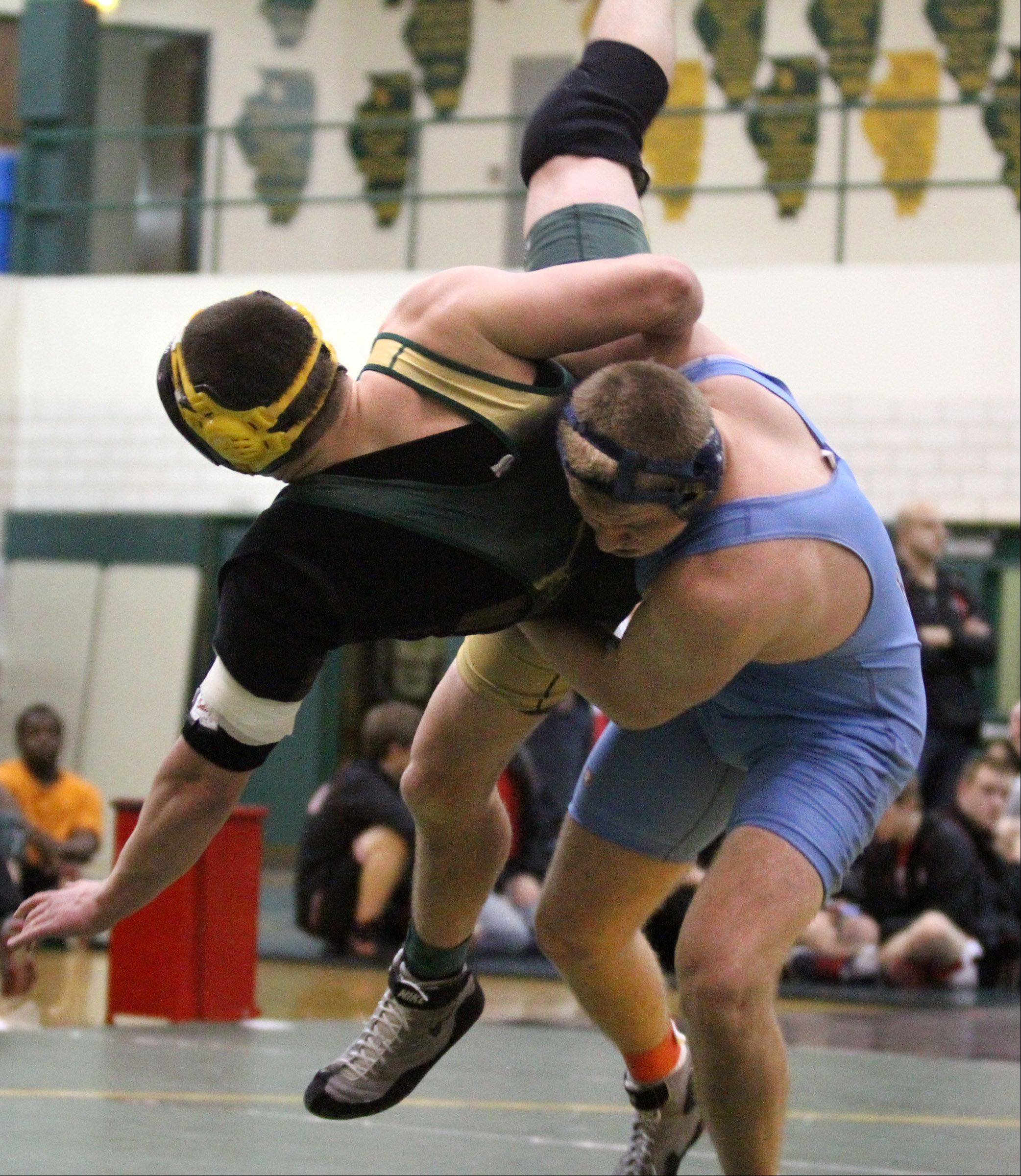 Prospect's Frank Walter throws Elk Grove's Dan Egan during the recent MSL championships. Walter competes at 220 in this weekend's Barrington sectional while Egan, a regional champ, is in action at Maine East.