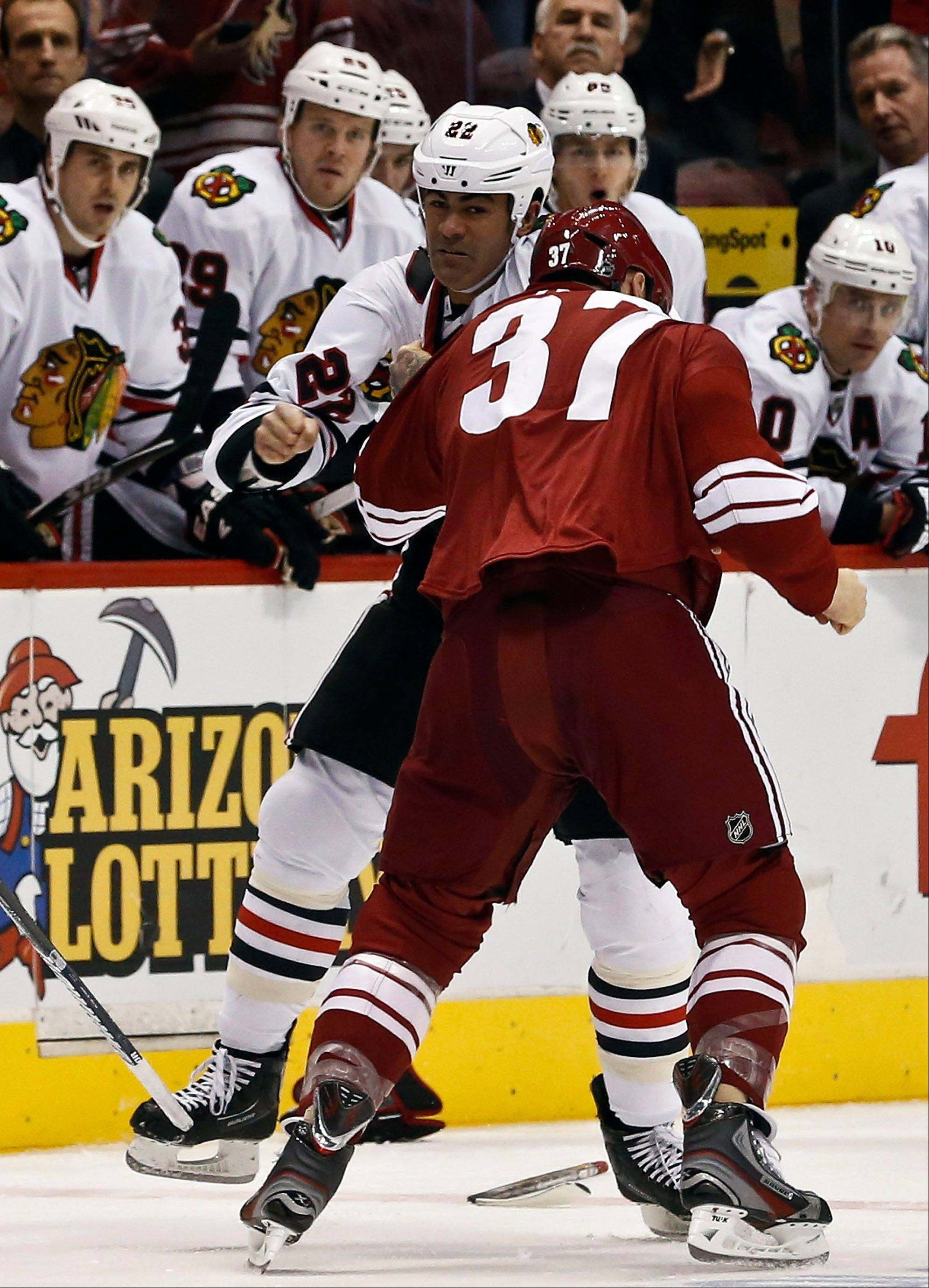"Phoenix Coyotes' Raffi Torres (37) fights with Jamal Mayers of the Blackhawks early in the first period of Thursday night's game in Glendale, Ariz. Patrick Kane said the fights ""pumped up"" the Hawks, who went on to claim a 6-2 win."