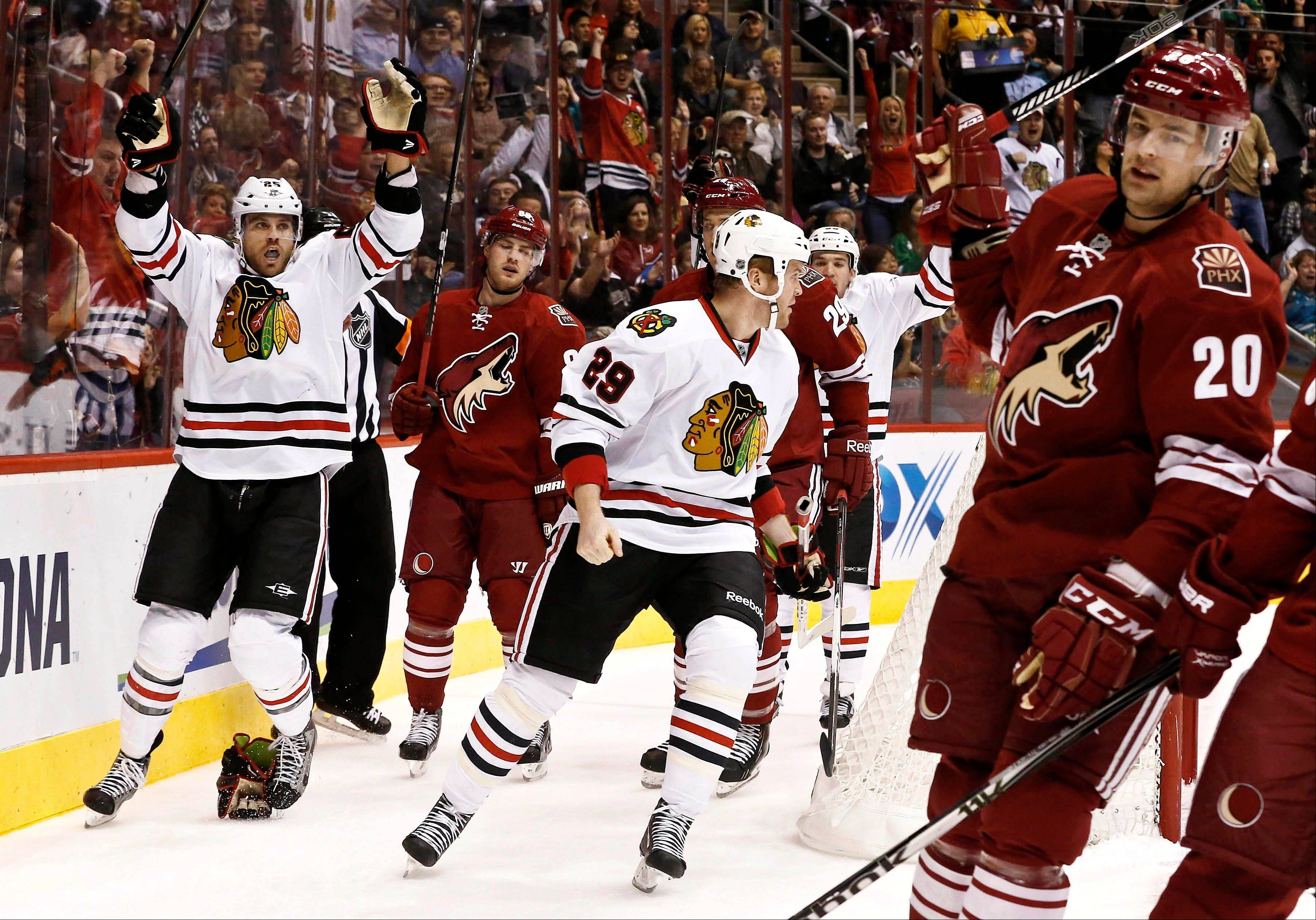 Viktor Stalberg, left, celebrates his goal with teammate Bryan Bickell (29) as Phoenix Coyotes' Chris Summers (20) and Mikkel Boedker, second from left, show their frustration Thursday night. The Blackhawks won the game, 6-2.