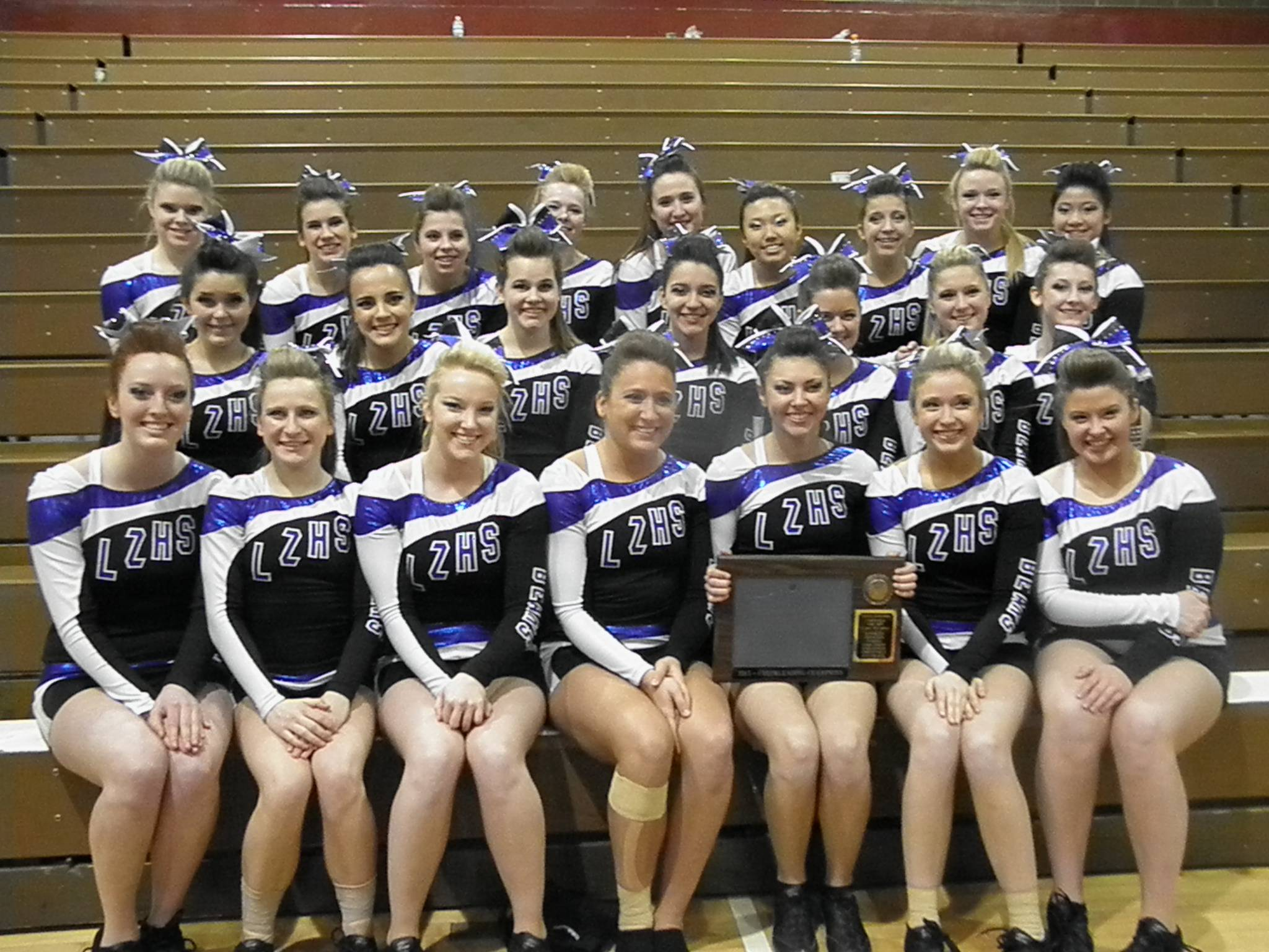 The Cheering Bears with their Lakes Division North Suburban Conference trophy on Jan. 20, 2013.