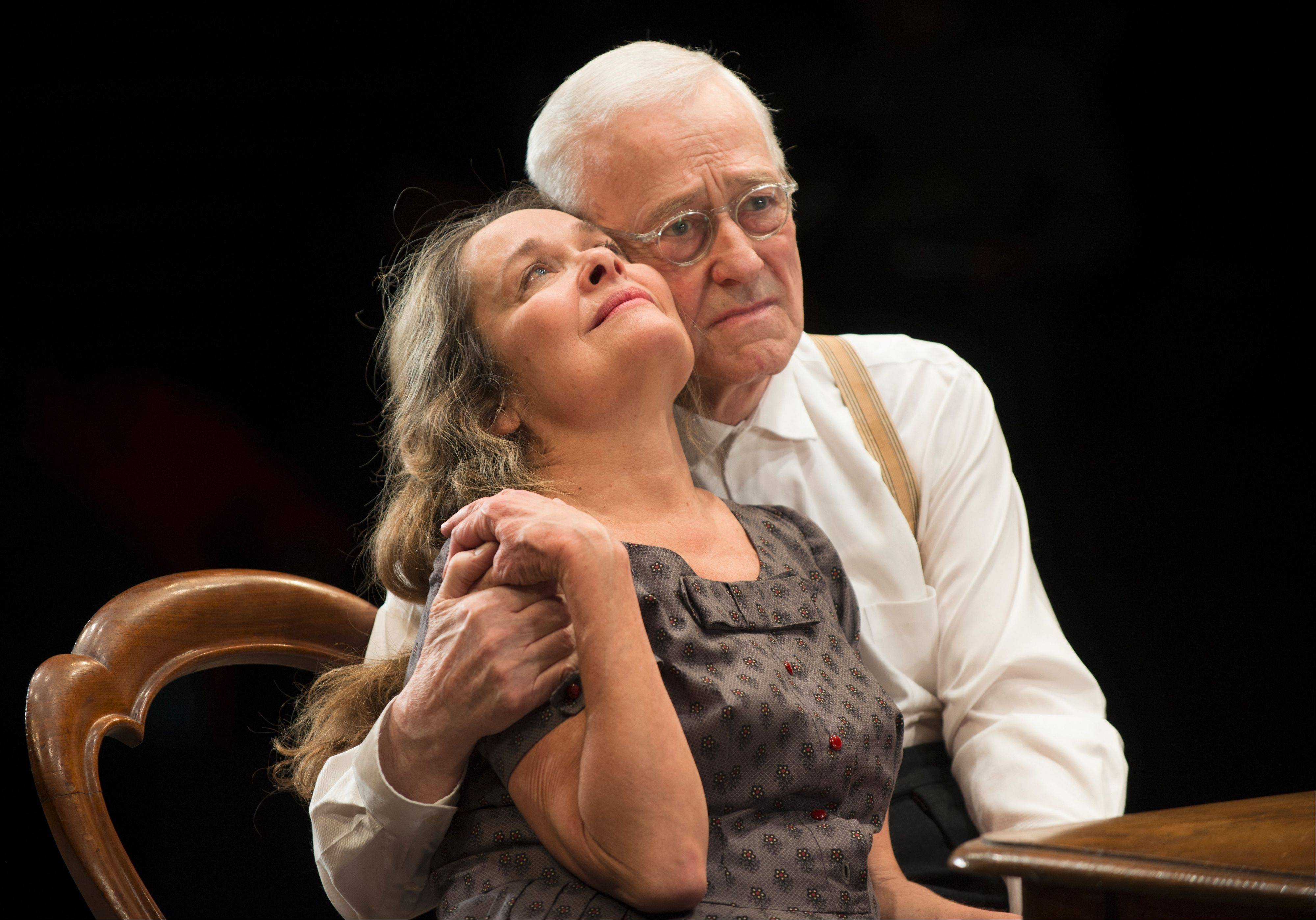 "Petey (John Mahoney) embraces his wife, Meg (Moira Harris) in Steppenwolf Theatre Company's production of ""The Birthday Party"" by Harold Pinter, directed by ensemble member Austin Pendleton."