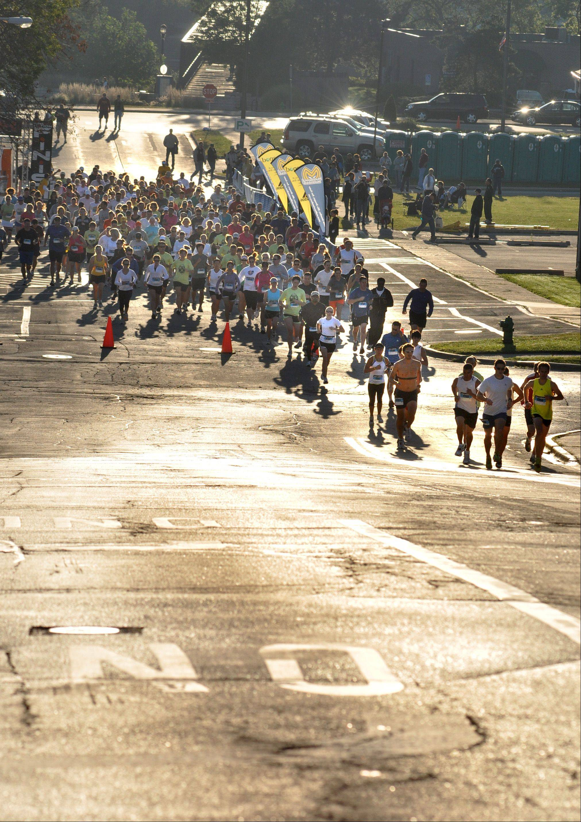 DAILY HERALD FILE PHOTO Runners begin the 2008 Half-Madness Marathon with a climb up the Houston Street hill in Batavia. The city had proposed moving the majority of the race on to the Fox River Trail.