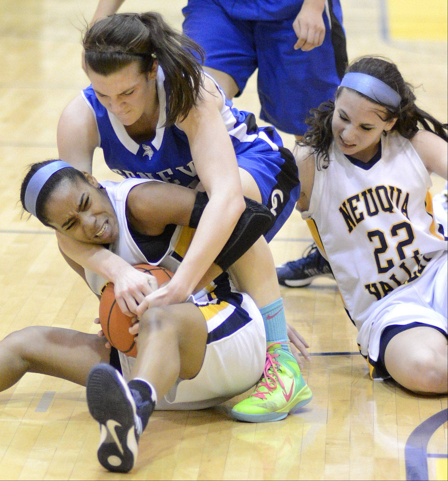 Neuqua Valley�s Malia Smith holds on to a loose ball while she and teammate Bryce Menendez fight off Geneva�s Sami Pawlak .