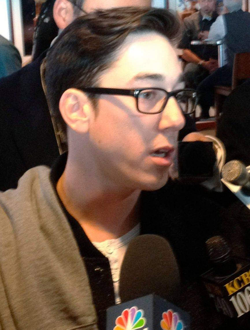 Sporting a brand-new look, Giants pitcher Tim Lincecum talks to reporters on Friday.