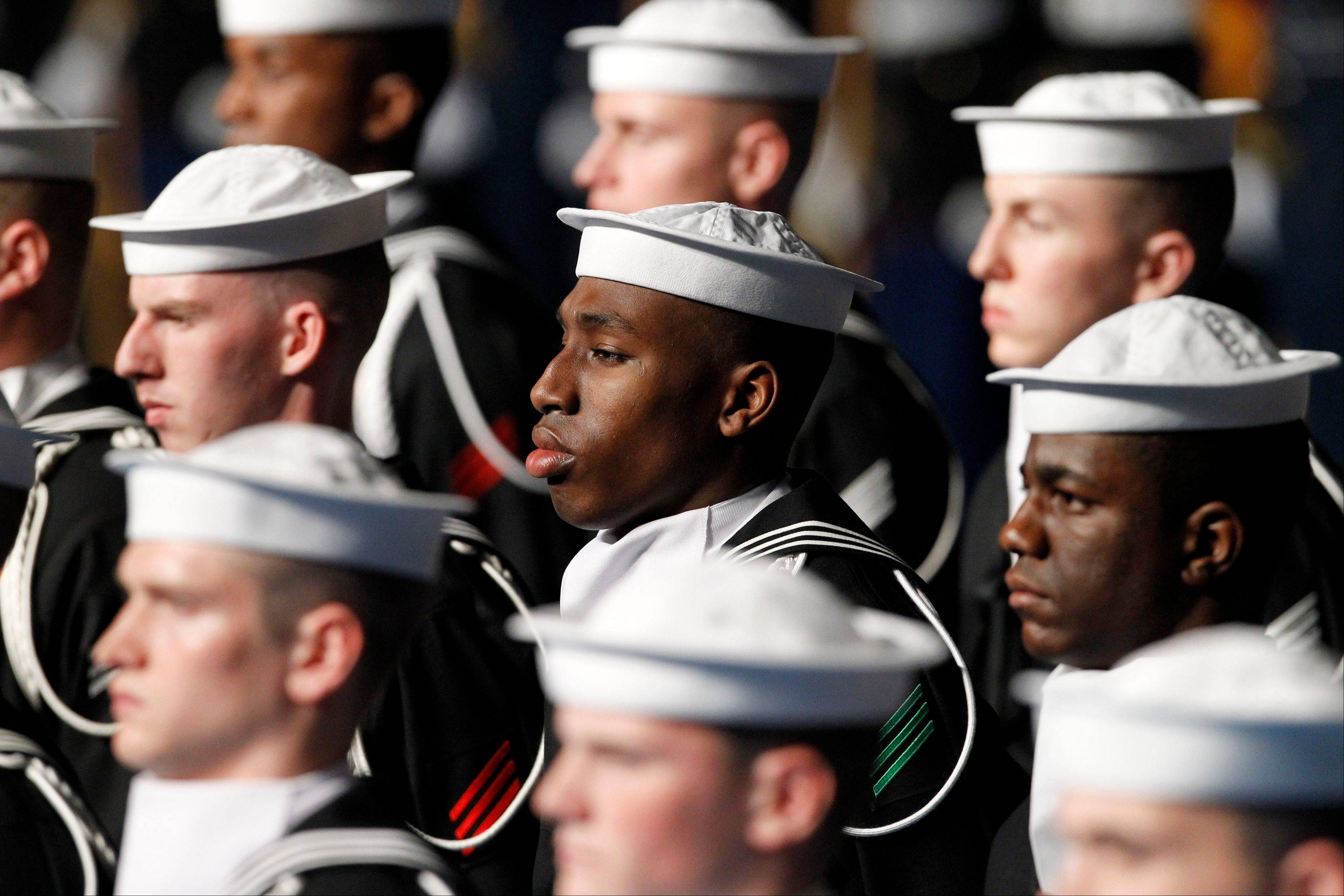 Members of the U.S. Navy Ceremonial and Guard Company stand Friday during an Armed Forces Farewell Ceremony to honor outgoing Defense Secretary Leon Panetta in Arlington, Va. The Pentagon's announcement this week of its intent to seek a 1 percent raise for the military in 2014 effectively set a cap for a 2014 civilian raise. In no recent year has the civilian raise exceeded the increase for military personnel.