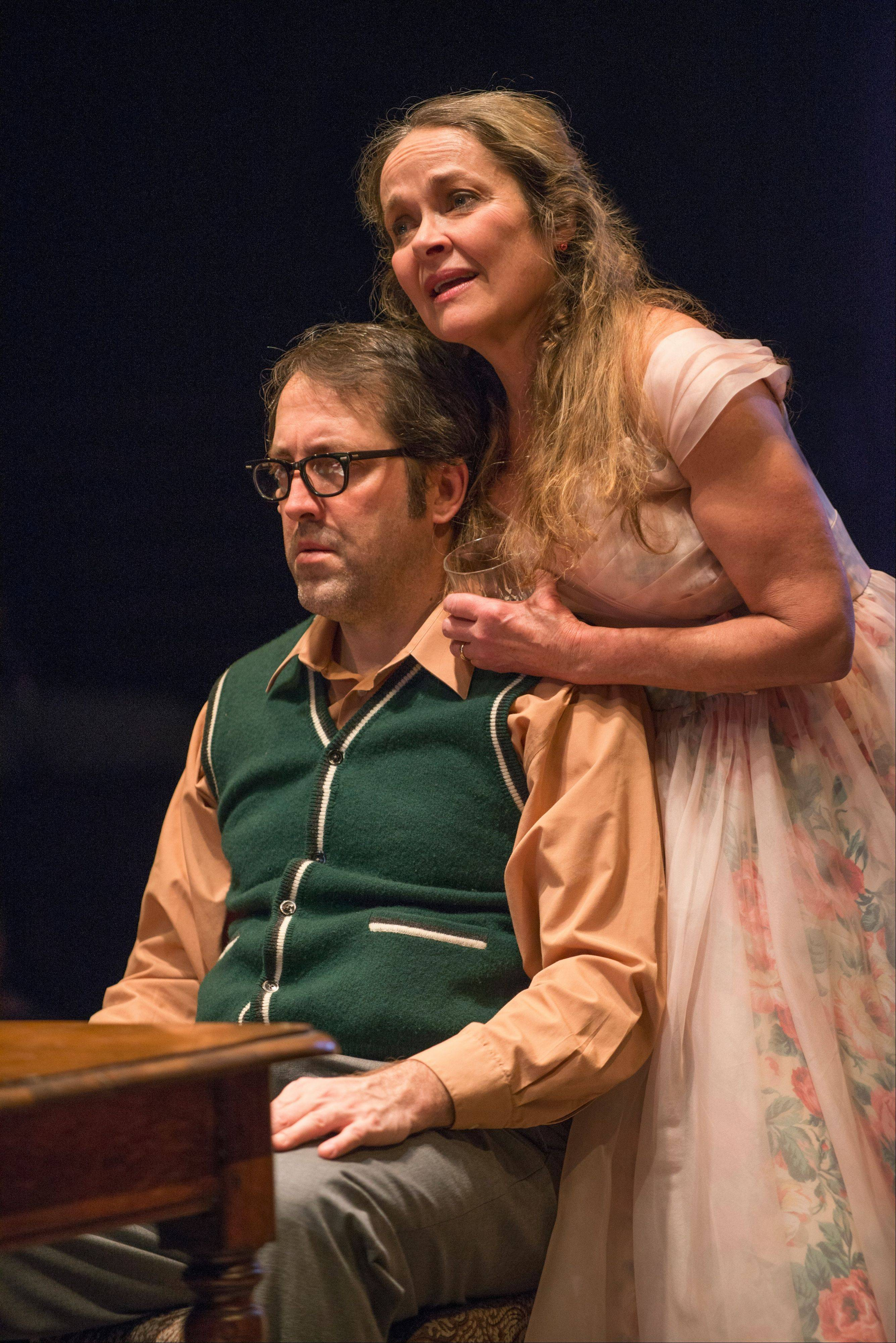 "Meg (Moira Harris) sings for Stanley (Ian Barford) on his birthday in Steppenwolf Theatre's production of Harold Pinter's ""The Birthday Party."""