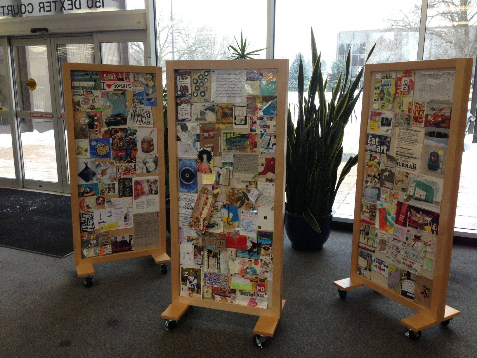 "A ""Trashpo"" art installation by Elgin artist Diane Keys on display at Elgin City Hall includes trash, found objects and recycled materials that were mailed to Keys by artists from 26 countries."