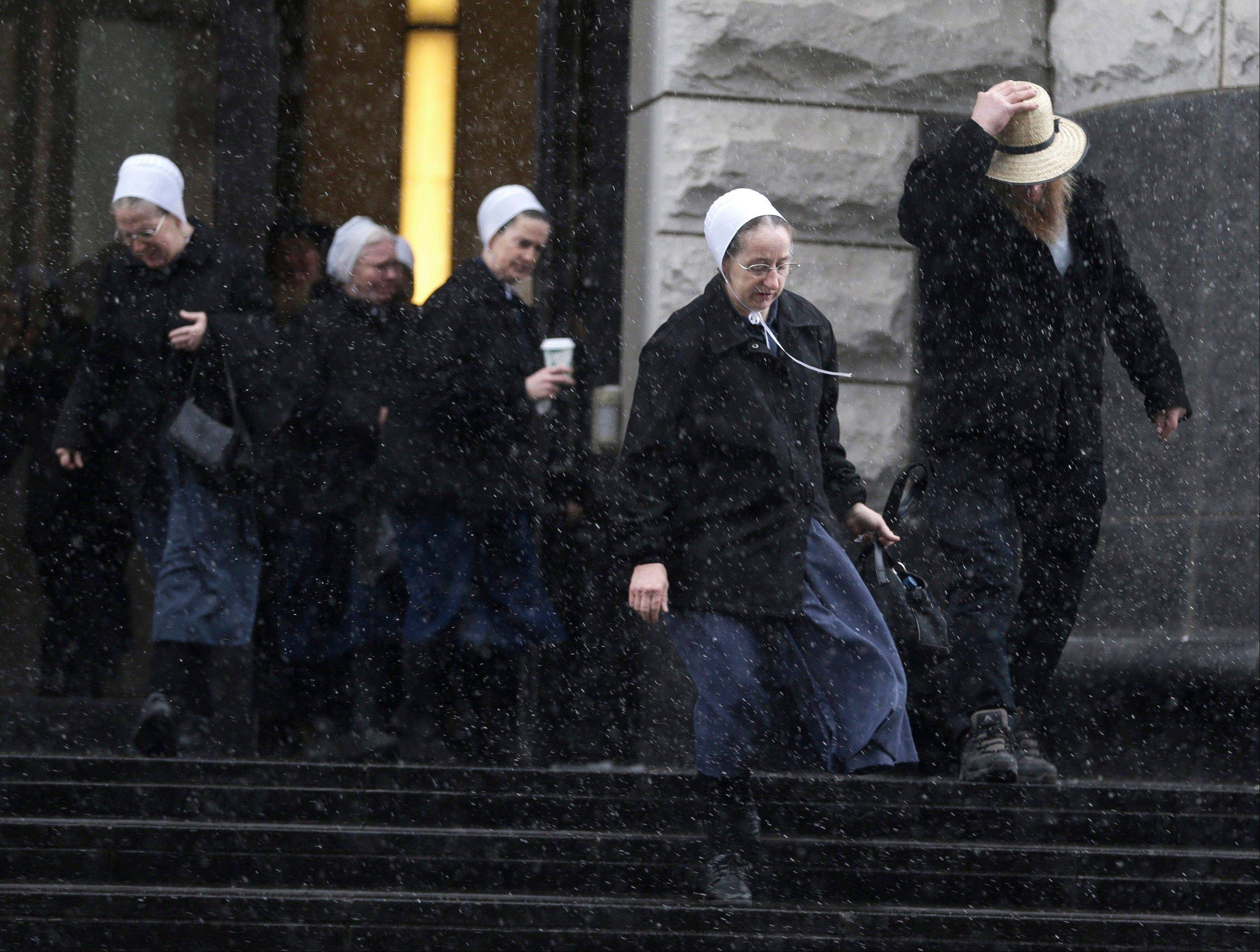 Amish men and women leave the U.S. Federal courthouse Friday in Cleveland.