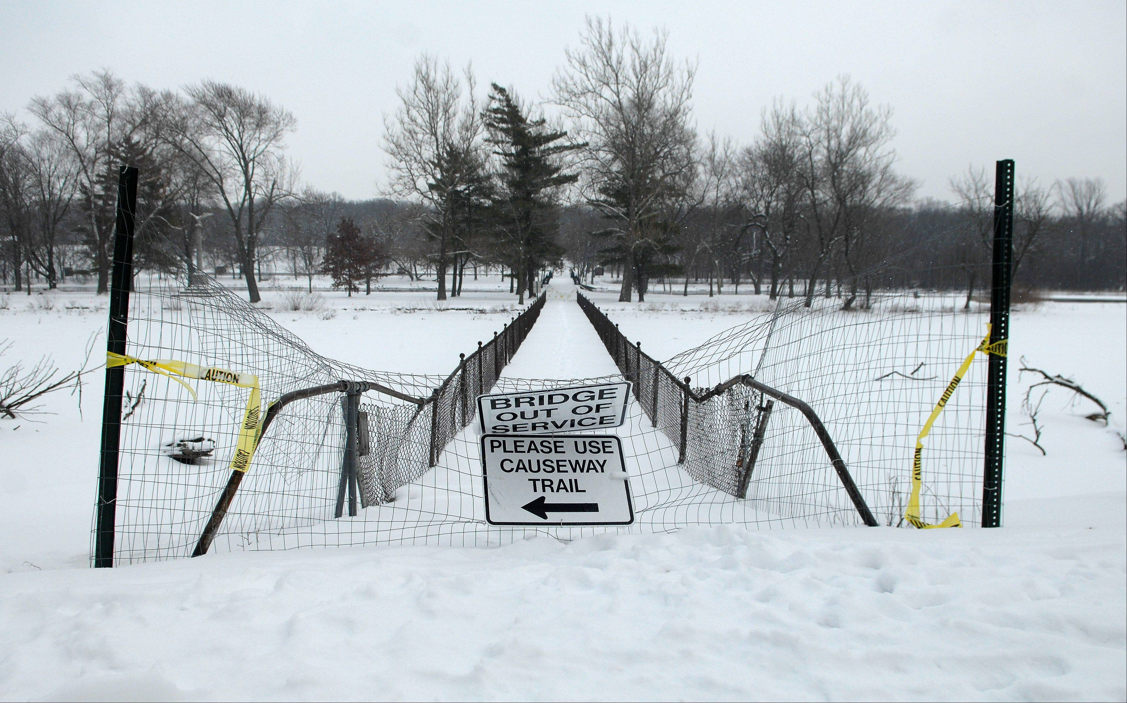 The western portion of the bridge that spans the Fox River in the Fabyan Forest Preserve has foundation cracks. The bridge may be up to 100 years old and a historic site, but it may be torn down.
