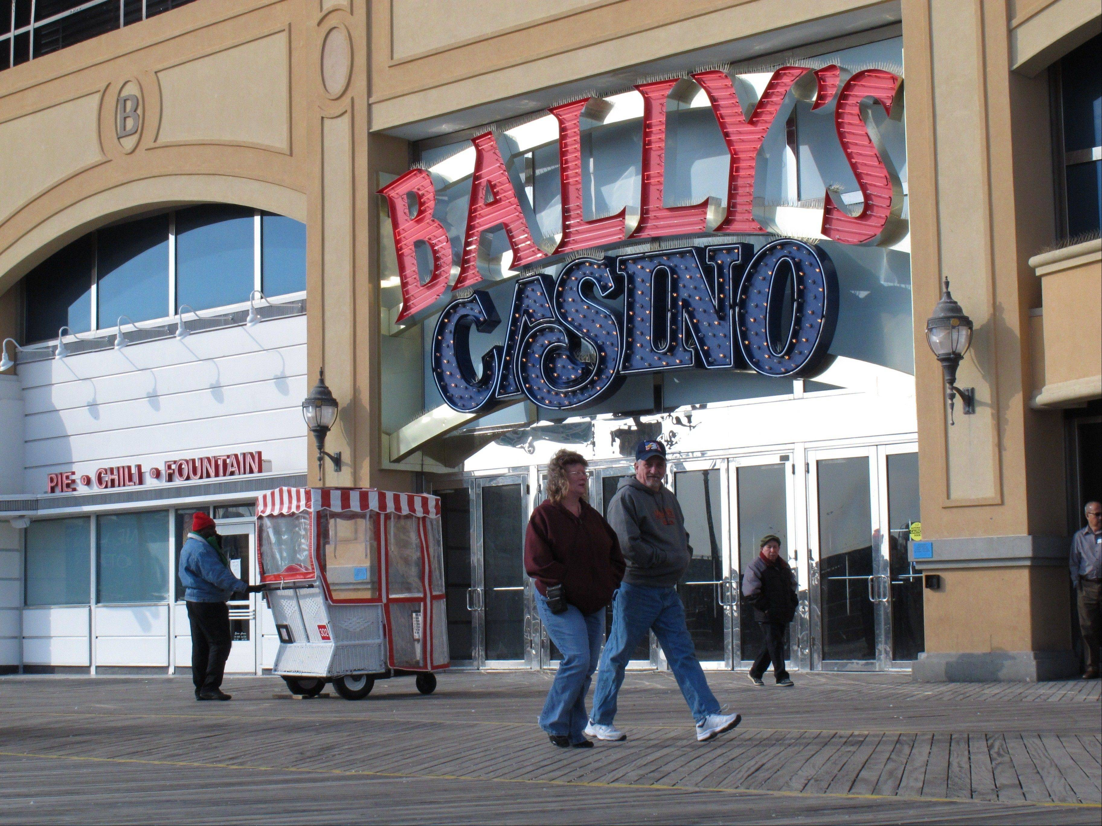 Pedestrians walk on the Atlantic City N.J. Boardwalk on Wednesday, a day before New Jersey Gov. Chris Christie vetoed a bill that would have allowed Internet gambling in his state. Christie said he would sign a future bill that sets a 10-year trial period for Internet gambling.