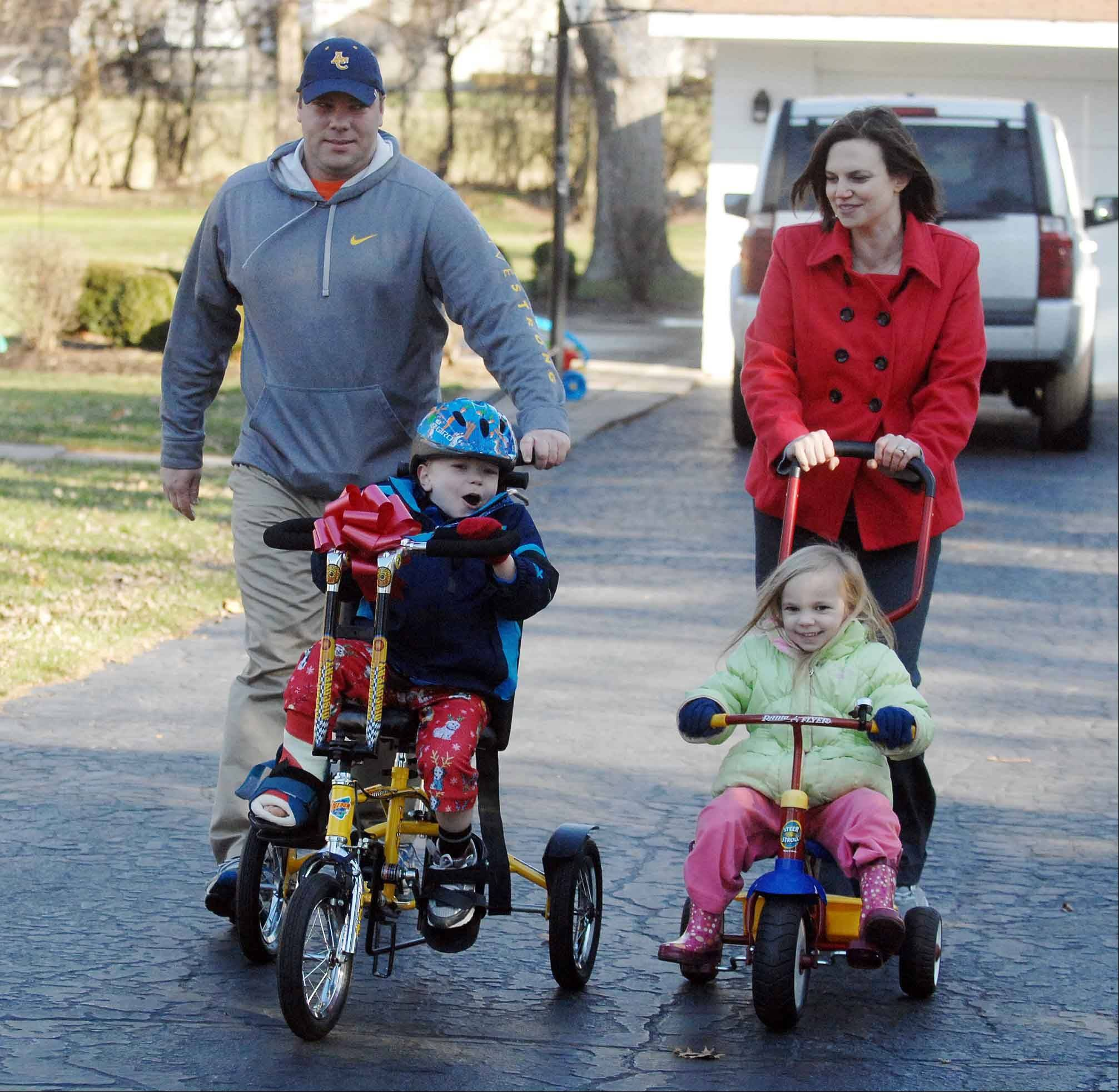 The family of 6-year-old Owen Payton, shown here in 2011 riding a therapeutic bike, is trying to raise $60,000 for expenses related to a heart transplant Owen is waiting to receive.