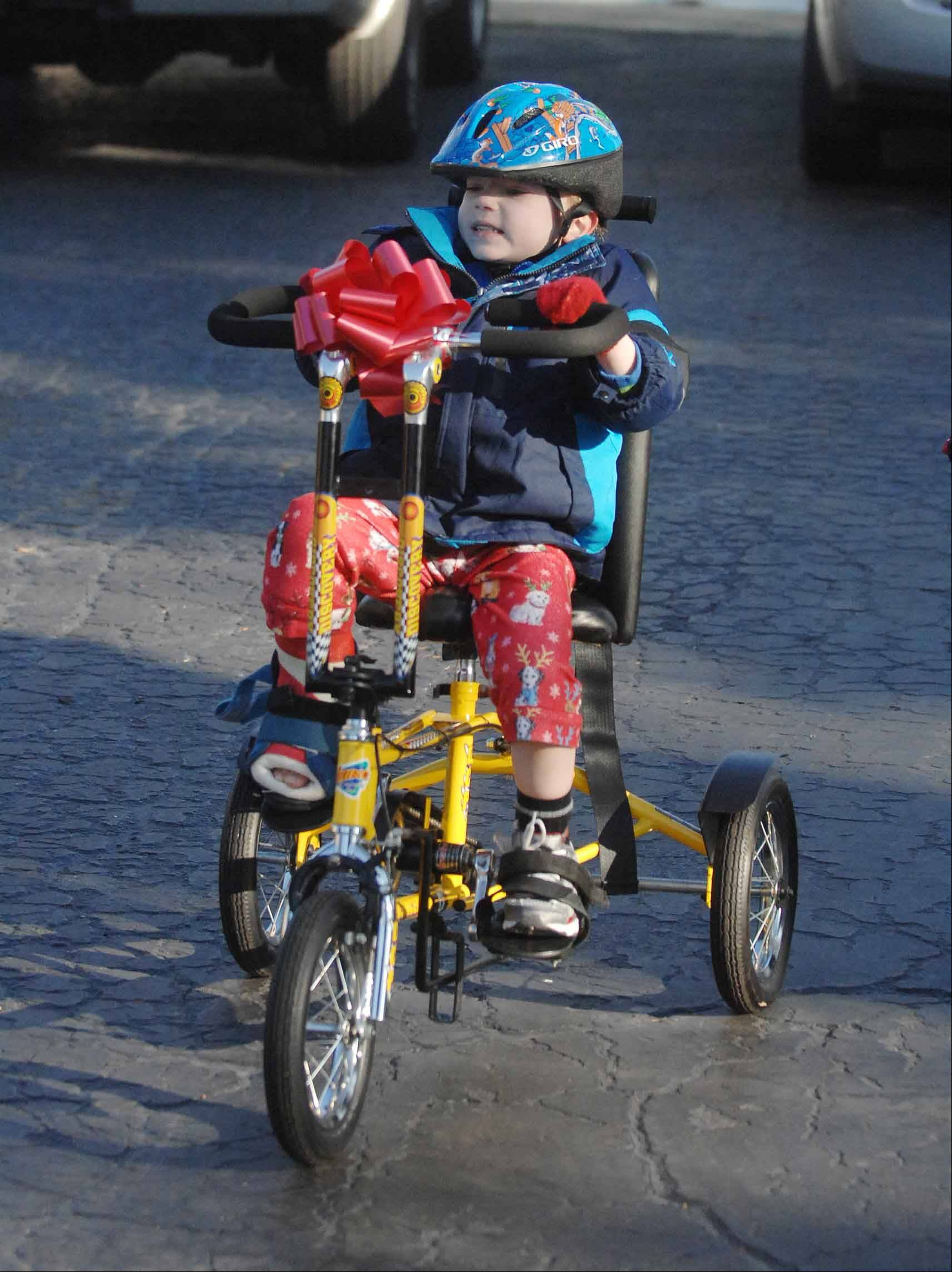 Owen Payton, 6, of an unincorporated area near West Chicago, rides a therapeutic bike he received for Christmas 2011 from Project Mobility. Owen's family is raising money with a bowling fundraiser Sunday for a heart transplant Owen is waiting to receive.