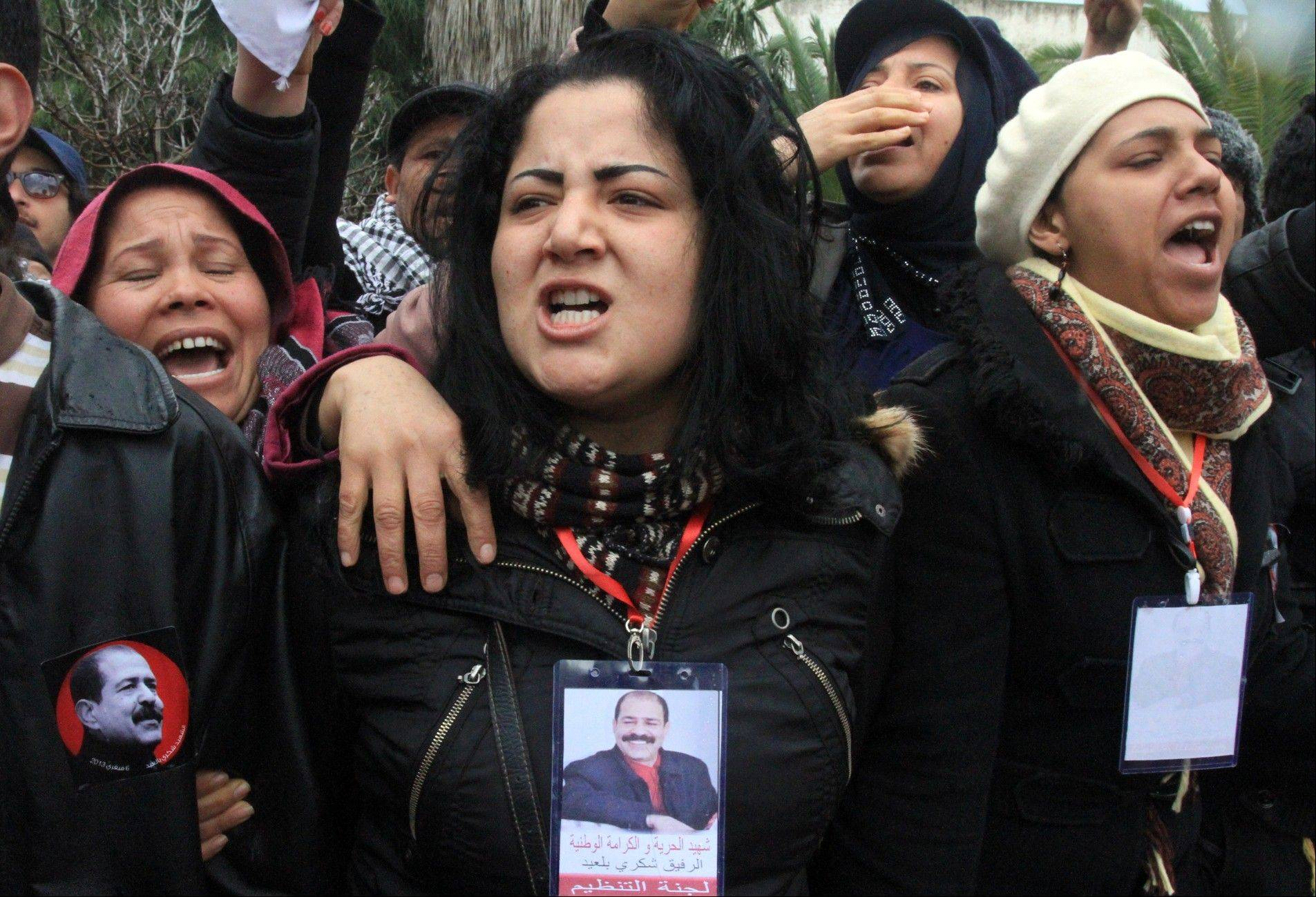 Tunisian women gather in front of the house of slain opposition leader Chokri Belaid's father prior to his funeral in Tunis, Friday, Feb. 8, 2013.