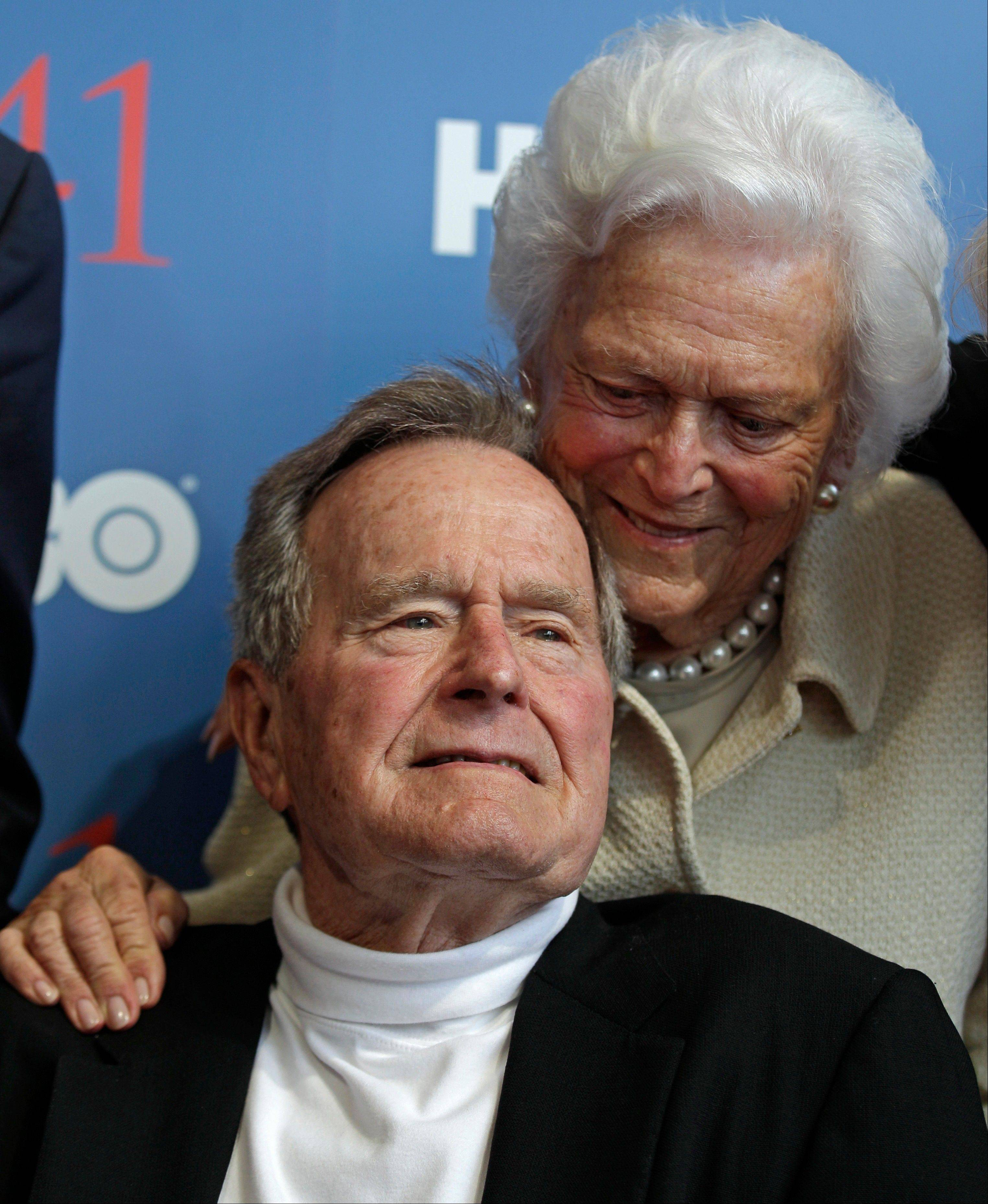 In this June 2012 photo, President George H.W. Bush, and his wife, Barbara, arrive for the premiere of HBO's documentary about his life in Kennebunkport, Maine. A criminal investigation is under way after a hacker apparently accessed private photos and emails sent between members of the Bush family, including both former presidents.