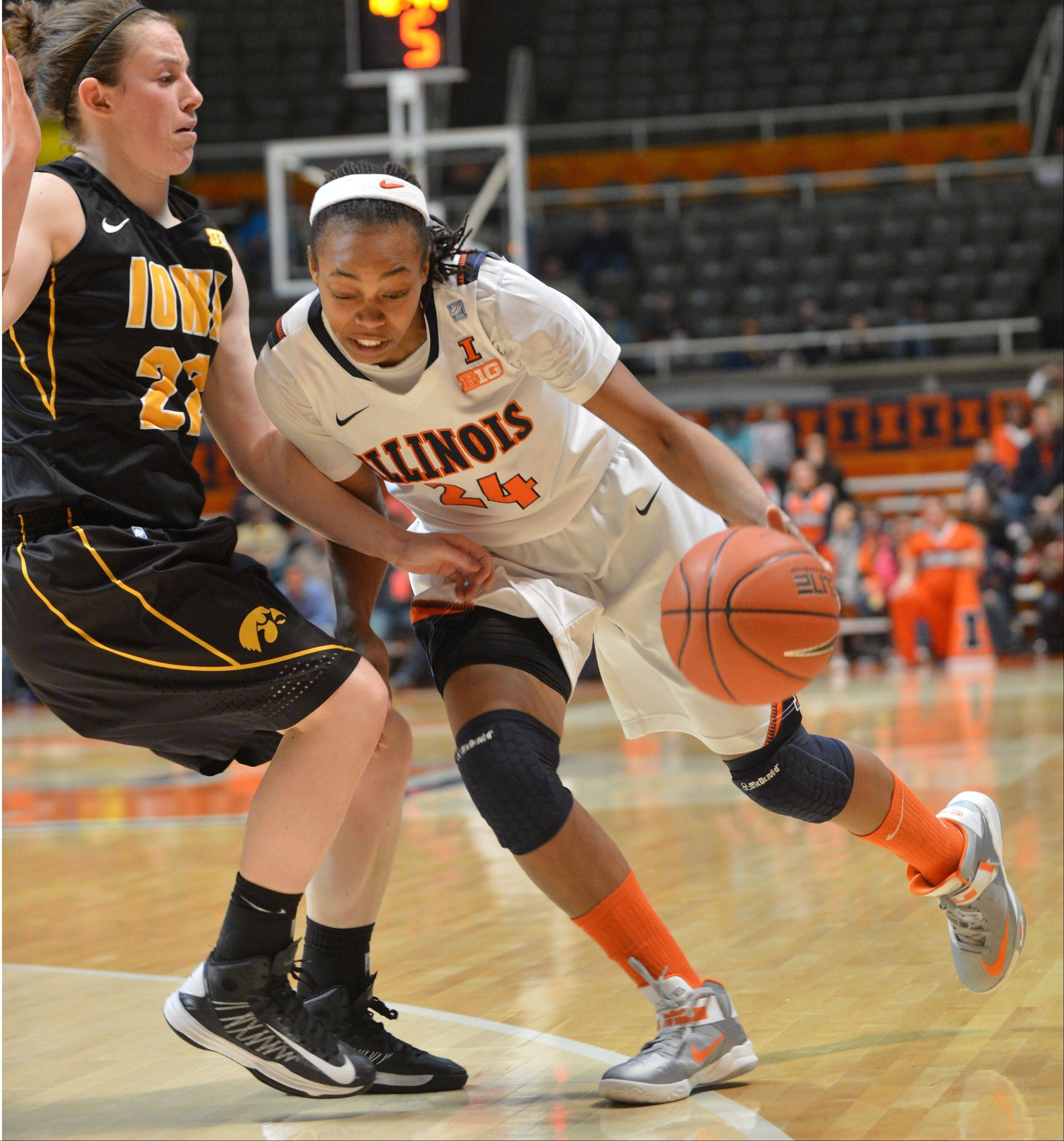 Illinois guard Ivory Crawford drives against Iowa guard Samantha Logic during the second half of a Jan. 31 game in Champaign. The Illini stand at 13-9 overall after a loss Thursday night at Michigan.