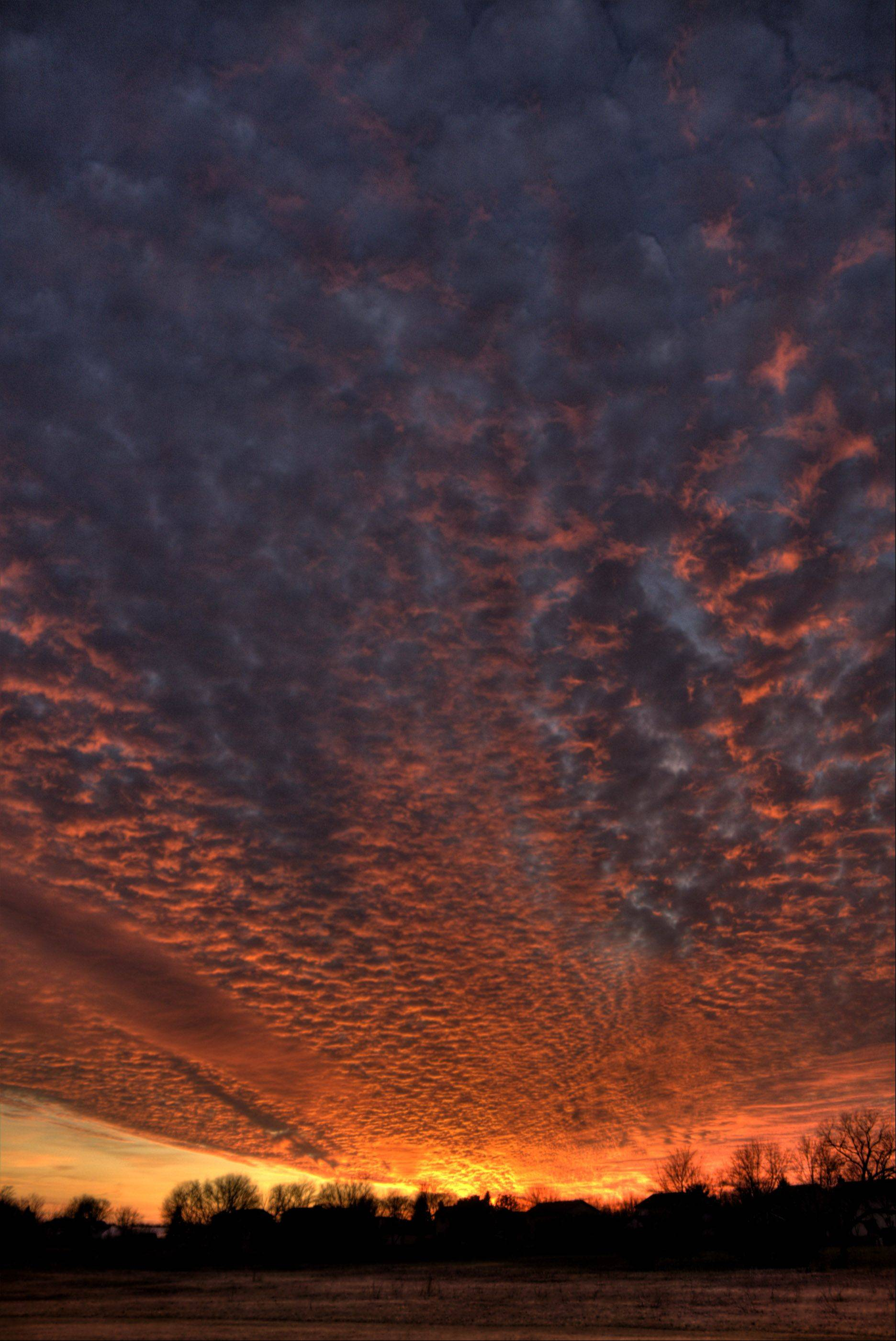 Here's a sunset captured near Kingsley Elementary School in Naperville. This photograph is comprised of twelve photographs taken at various exposures which were meshed together in Photoshop using the Photomatix HDR plug in.