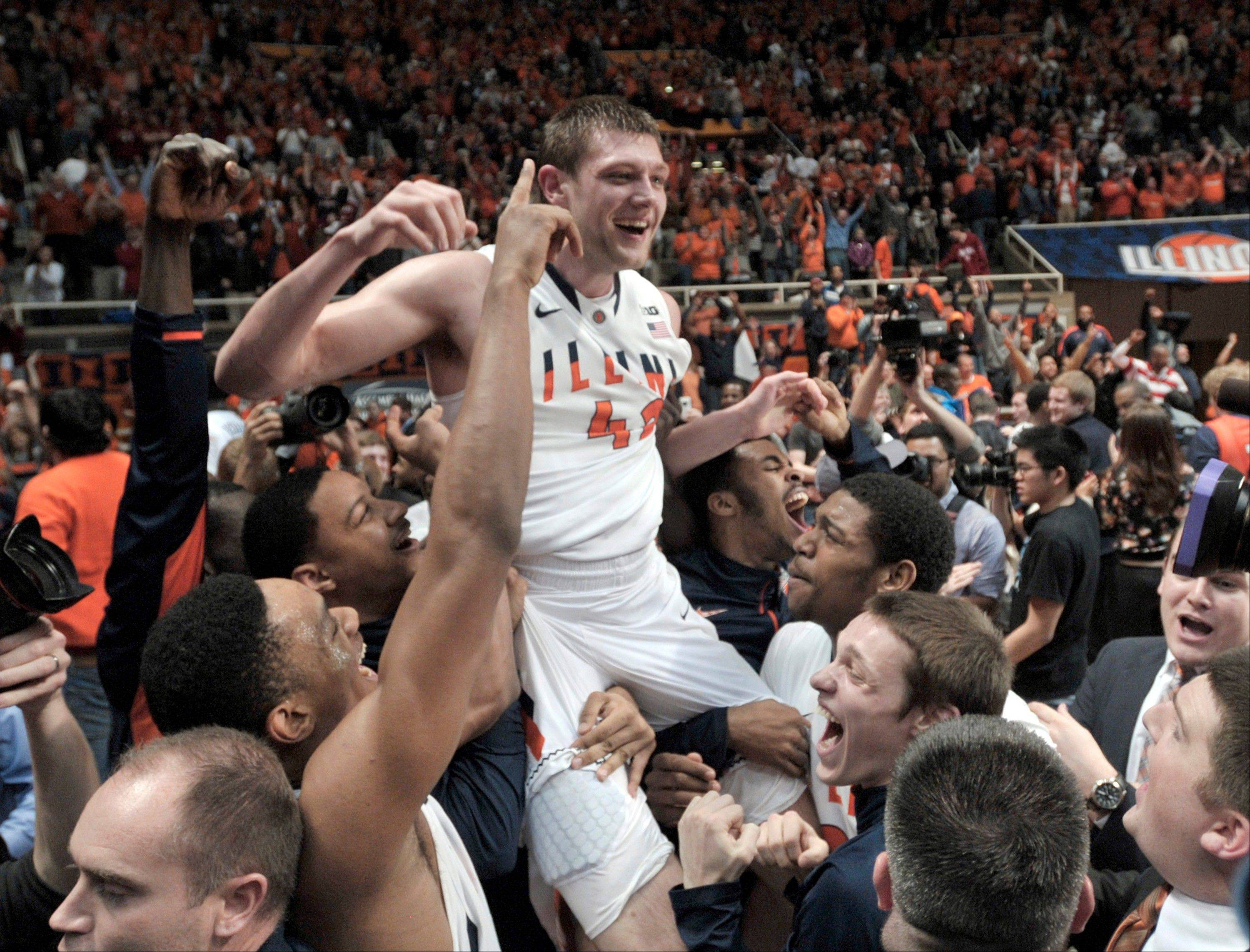 Illinois' Tyler Griffey (42) is hoisted onto his teammates' shoulders after hitting the winning basket, giving Illinois a 74-72 win over No. 1-ranked in an NCAA college basketball game at Assembly Hall in Champaign, Ill., on Thursday Feb. 7, 2013.