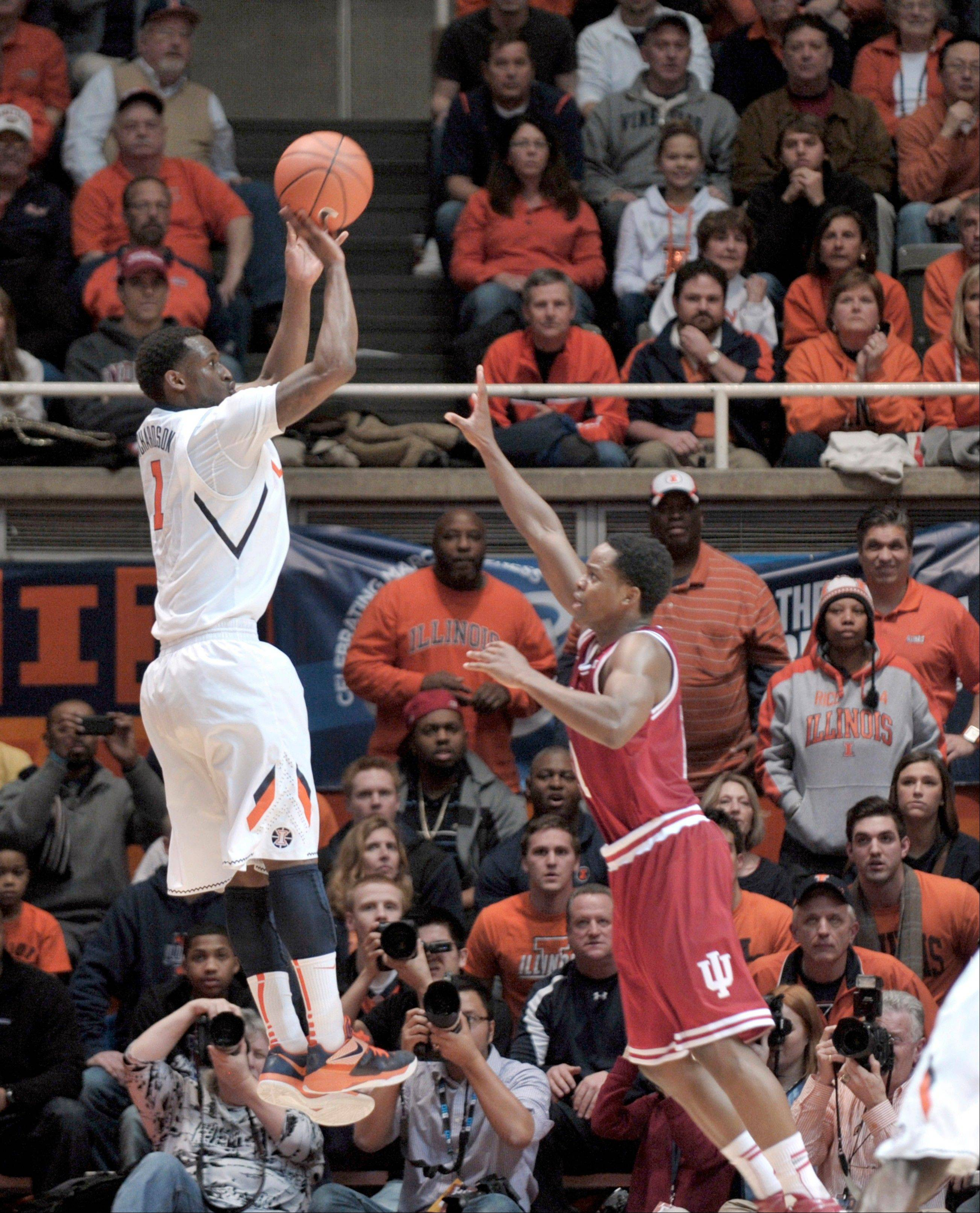 "Illinois guard D.J. Richardson goes up for a 3-point shot over Indiana's Kevin ""Yogi"" Ferrell at Assembly Hall on Thursday, Feb. 7, 2013. Richardson scored 8 consecutive points to help Illinois defeat No. 1 Indiana 74-72."