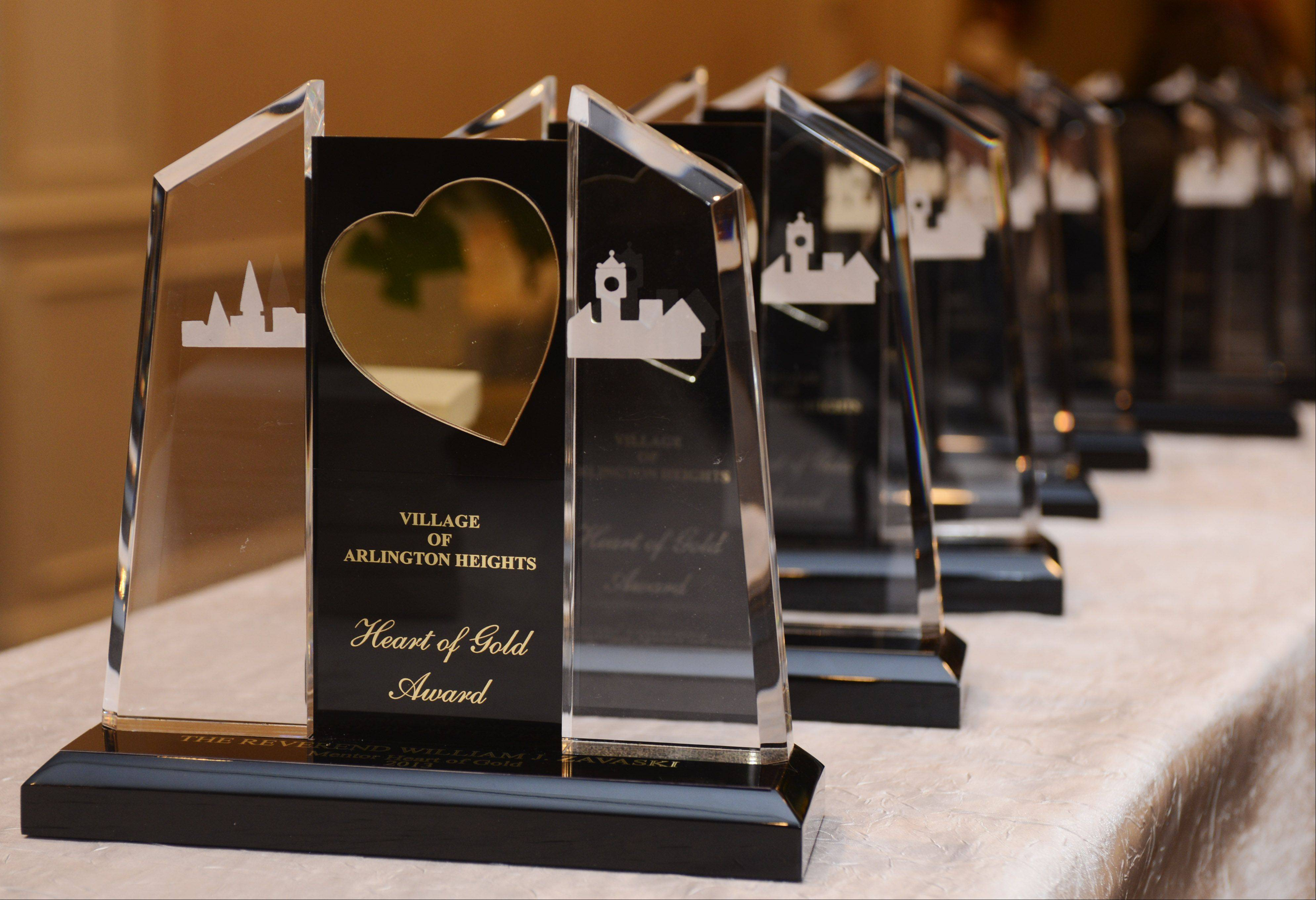 JOE LEWNARD/jlewnard@dailyherald.com Awards are lined up on the front table Saturday before the 2013 Hearts of Gold Awards Dinner.