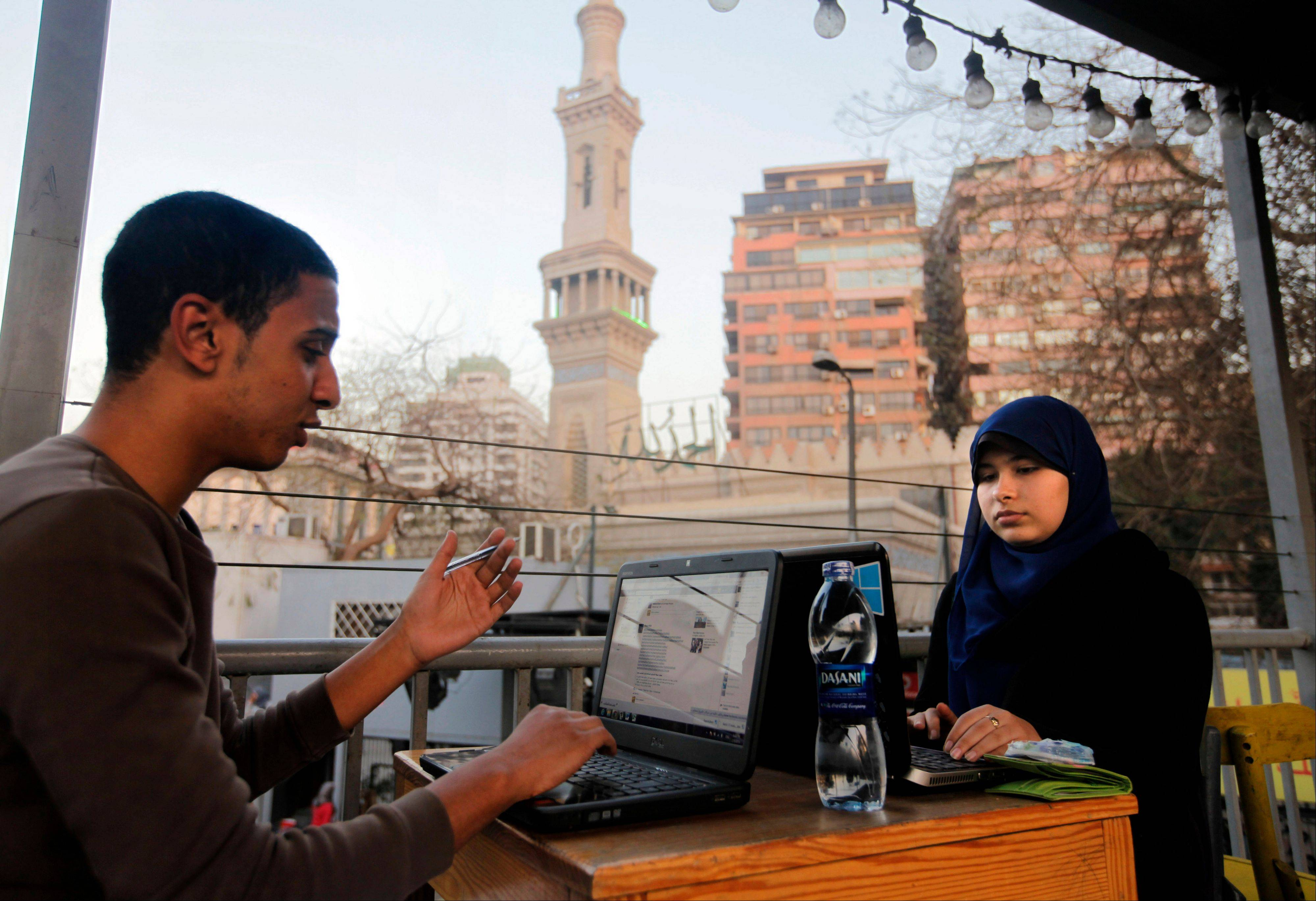 Egyptians log on to the Internet at a community center in front of a mosque in Cairo, Egypt, Saturday. A Cairo court on Saturday ordered the government to block access to the video-sharing website YouTube for 30 days for carrying an anti-Islam film that caused deadly riots across the world.