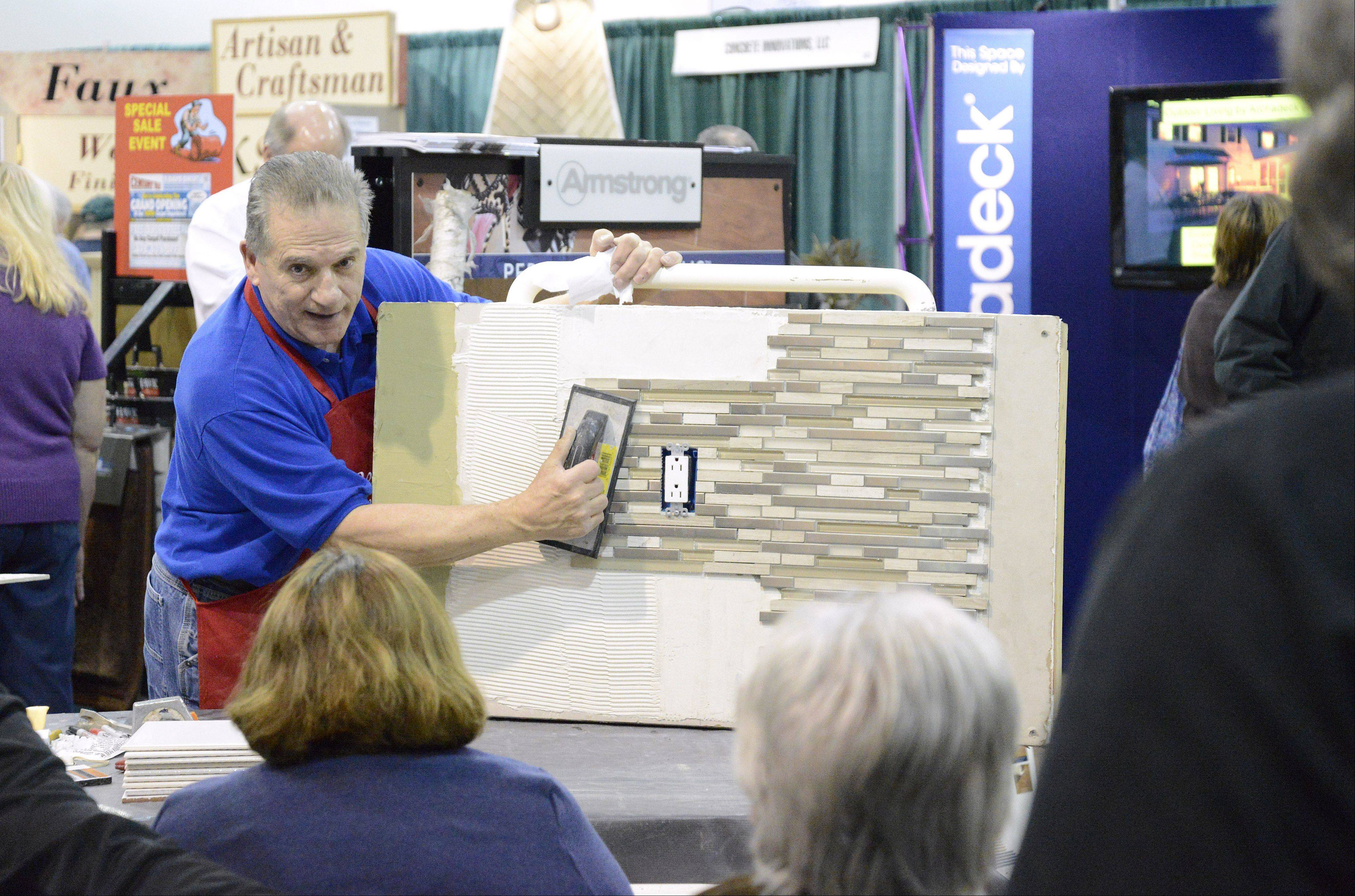 Pete Lettecci (aka �Pete the Pro�) gives a demonstration on how to grout tile in the Century Tile & Carpet booth at the Old House New House Home Show Saturday. Lettecci, who lives in Lake Zurich, teaches about 200 ceramic tile installation classes a year for Century Tile & Flooring. The show continues at the Mega Expo Center and Ballroom at Pheasant Run Resort Sunday from 10 a.m. to 5 p.m.