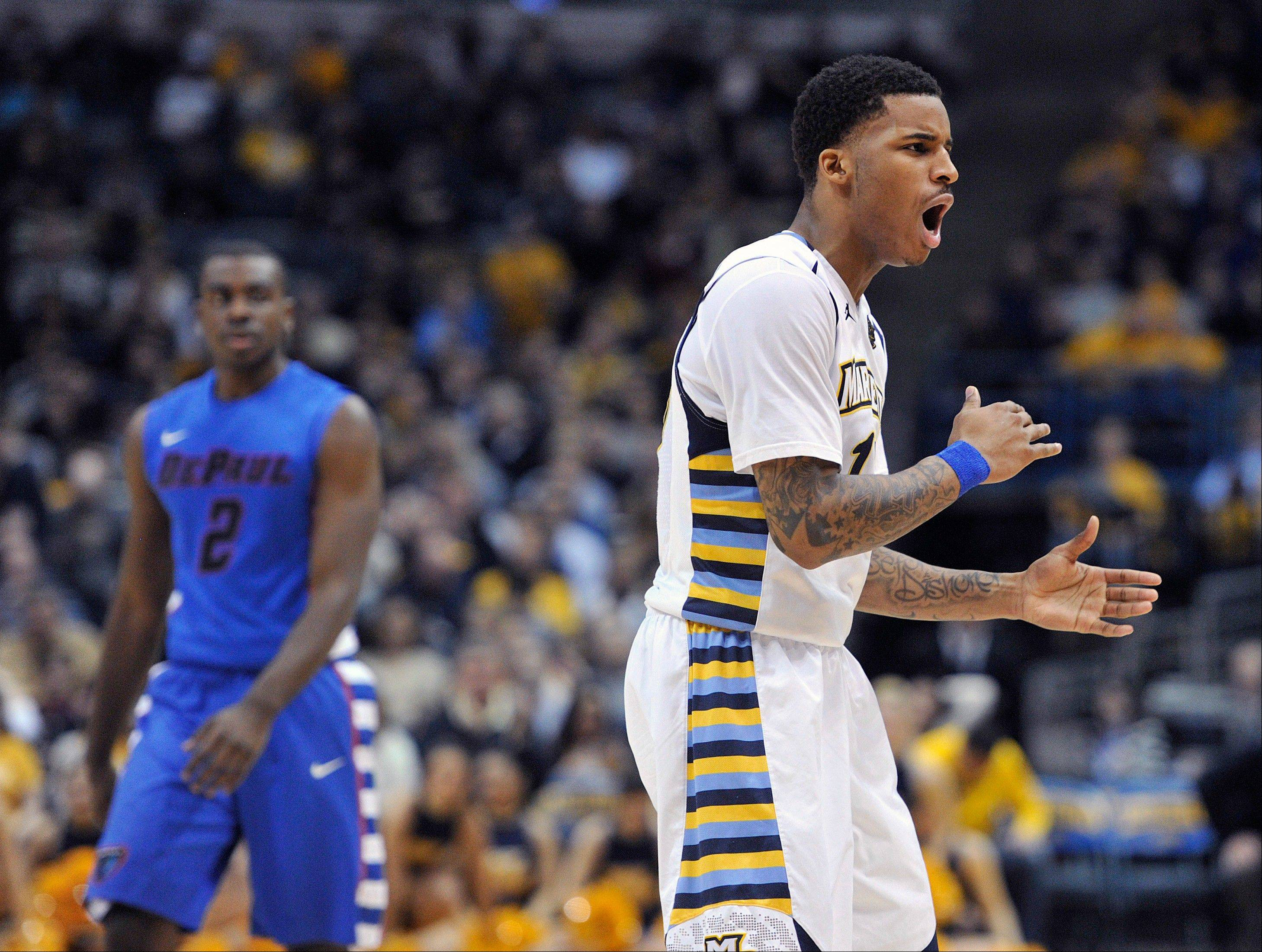 DePaul's Edwind McGhee, left, walks toward the bench as Marquette's Vander Blue celebrates a basket during the second half of an NCAA college basketball game Saturday, Feb. 9, 2013, in Milwaukee. (AP Photo/Jim Prisching)