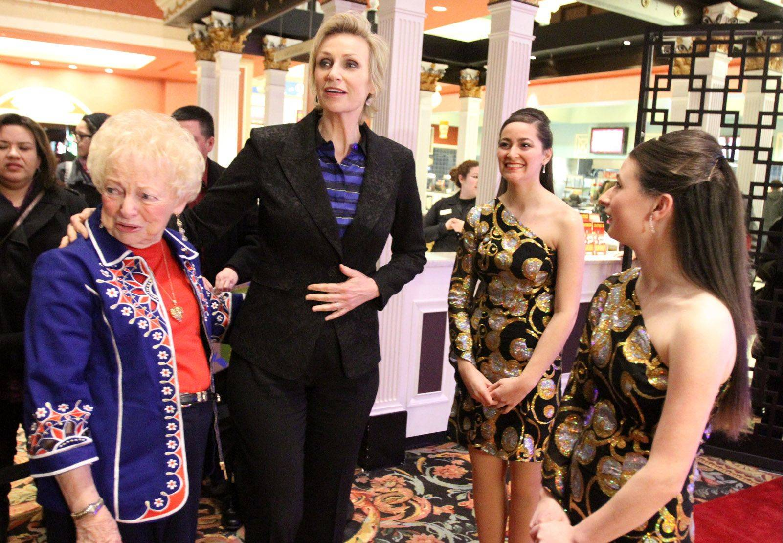 Rolling Meadows High School Show Choir members Amanda Torres and Korinne Yonan greet actress Jane Lynch and her Aunt Marge Lynch at the Chicago Film Critics Association 24th Annual Awards Show on Saturday at Muvico Theaters in Rosemont.