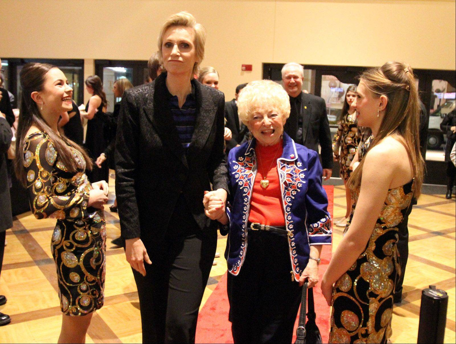 Rolling Meadows High School Show Choir members greet actress Jane Lynch and her Aunt Marge Lynch to the Chicago Film Critics Association 24 Annual Awards Show on Saturday at Muvico Theaters in Rosemont.