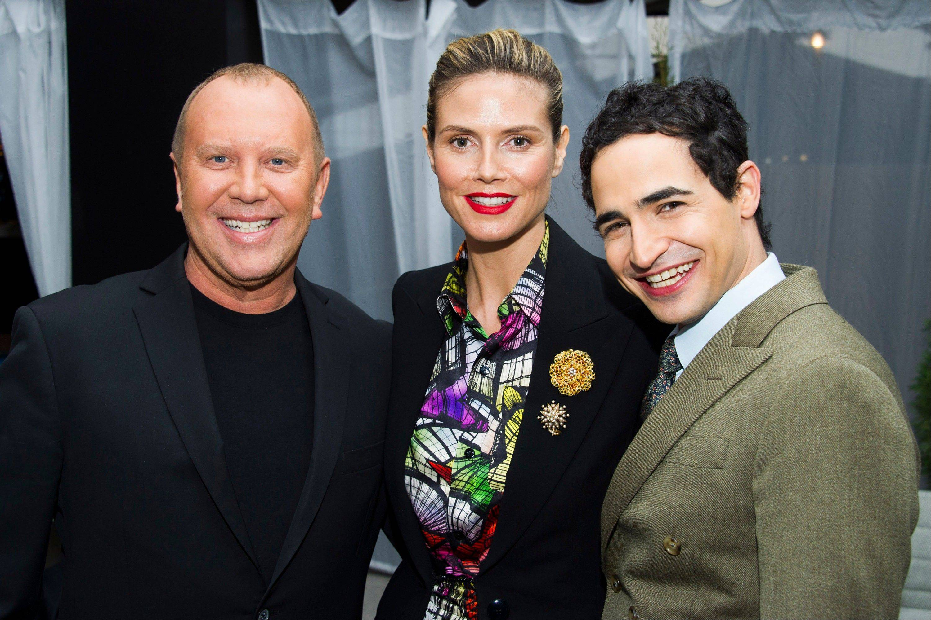 Michael Kors, from left, Heidi Klum and Zac Posen pose Friday before the Fall 2013 Project Runway fashion show in New York.
