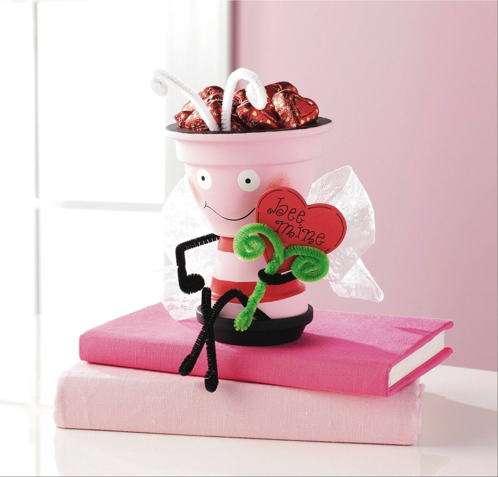 A Clay Pot Valentine Love Bee, sold at Michaels, can be filled with whatever candy your Valentine adores.