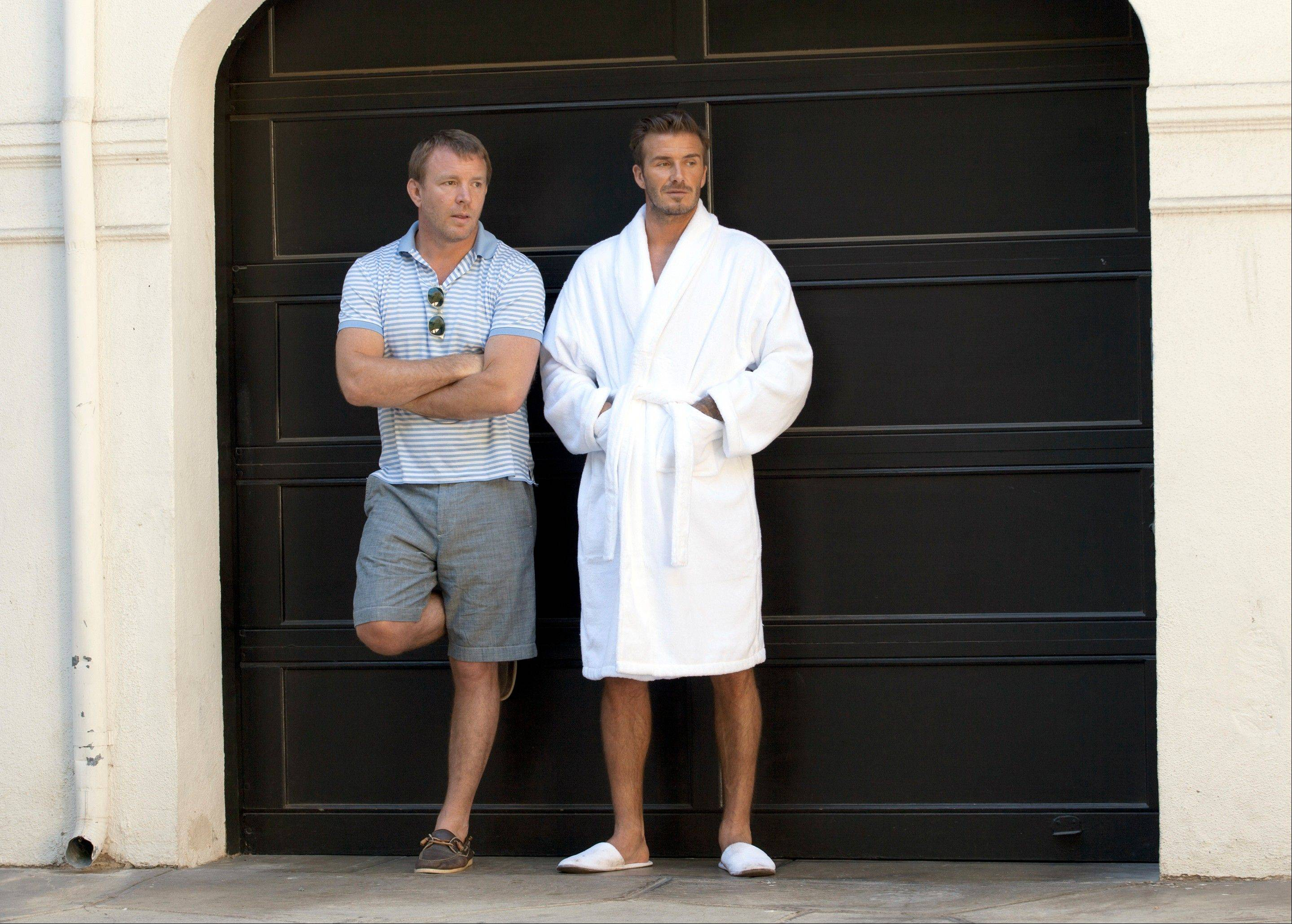 Soccer star David Beckham, right, and director Guy Ritchie on the set of Beckham's newest ad campaign for his bodywear collection in Los Angeles.