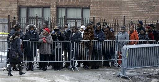 Mourners wait outside the Greater Harvest Missionary Baptist Church for the funeral service of Hadiya Pendleton Saturday, Feb. 9, 2013, in Chicago. The shooting death of the 15-year-old honor student has drawn attention to the staggering gun violence in the nation's third-largest city.