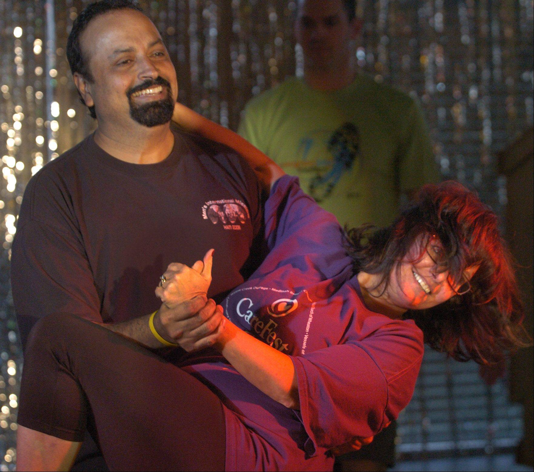 "Adil and Kathy Jaffer rehearse the 2013 Team Finale Dance for ""Dancing With The Geneva Stars."""
