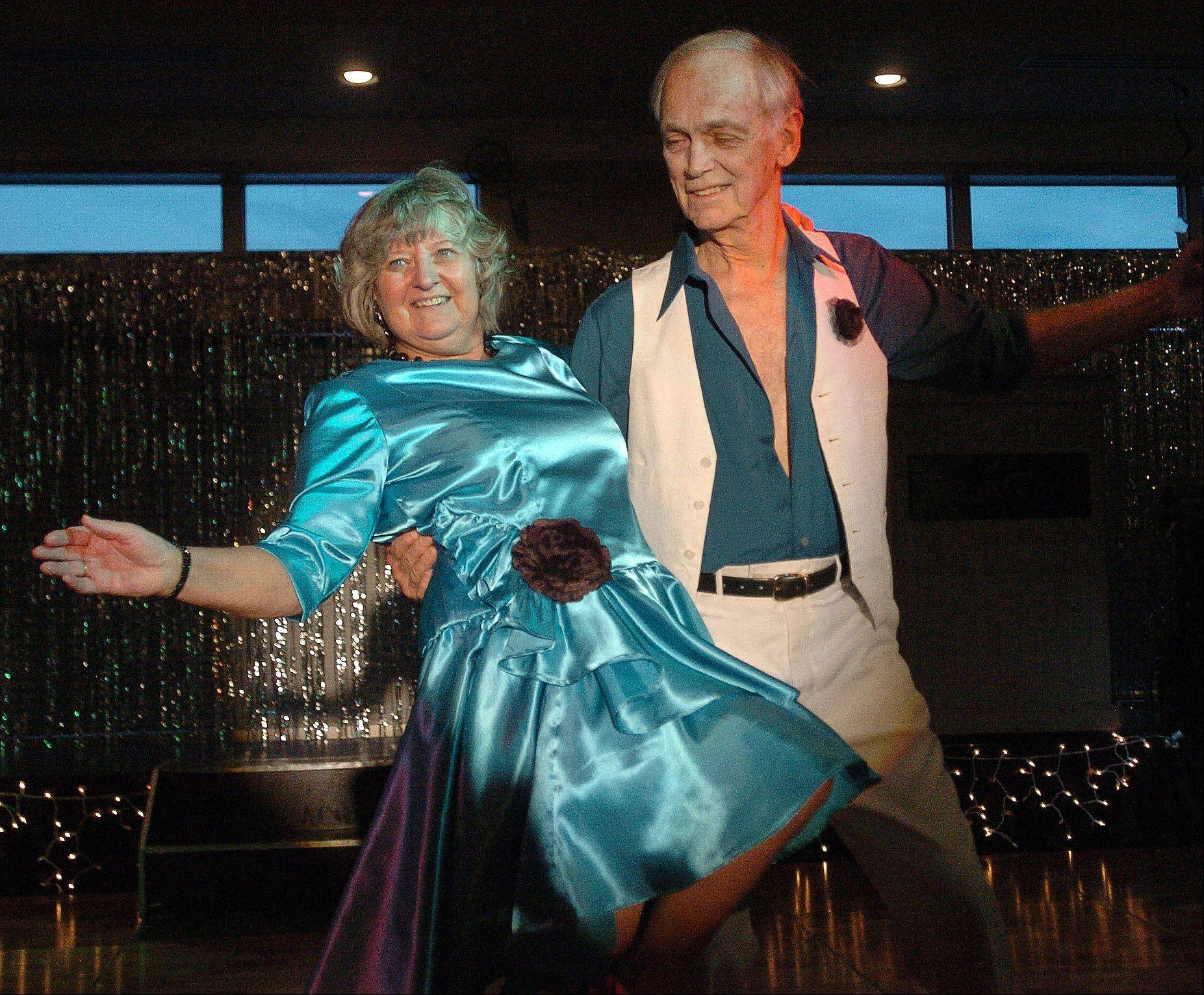 "Sam Hill and Dorothy Flanagan rehearse their Rumba number for ""Dancing With The Geneva Stars."""