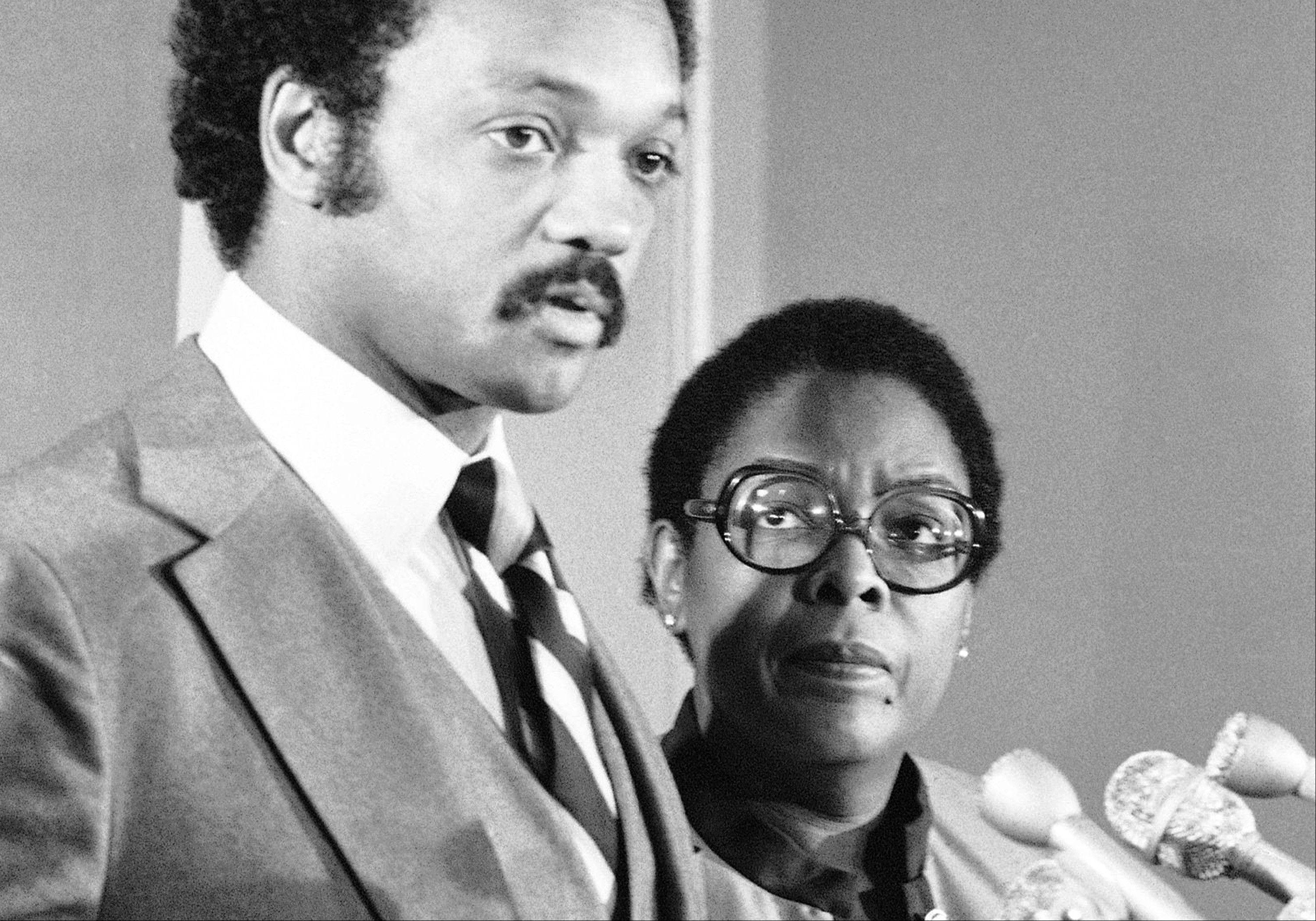 In this Nov. 12, 1980, file photo former Congresswoman Cardiss Collins, right, appears at a news conference with the Rev. Jesse Jackson in Washington. Collins, the first African-American woman to represent Illinois in Congress, died Sunday, Feb. 3, 2013 of complications from pneumonia at a Virginia hospital, a family friend announced on Tuesday, Feb. 5.