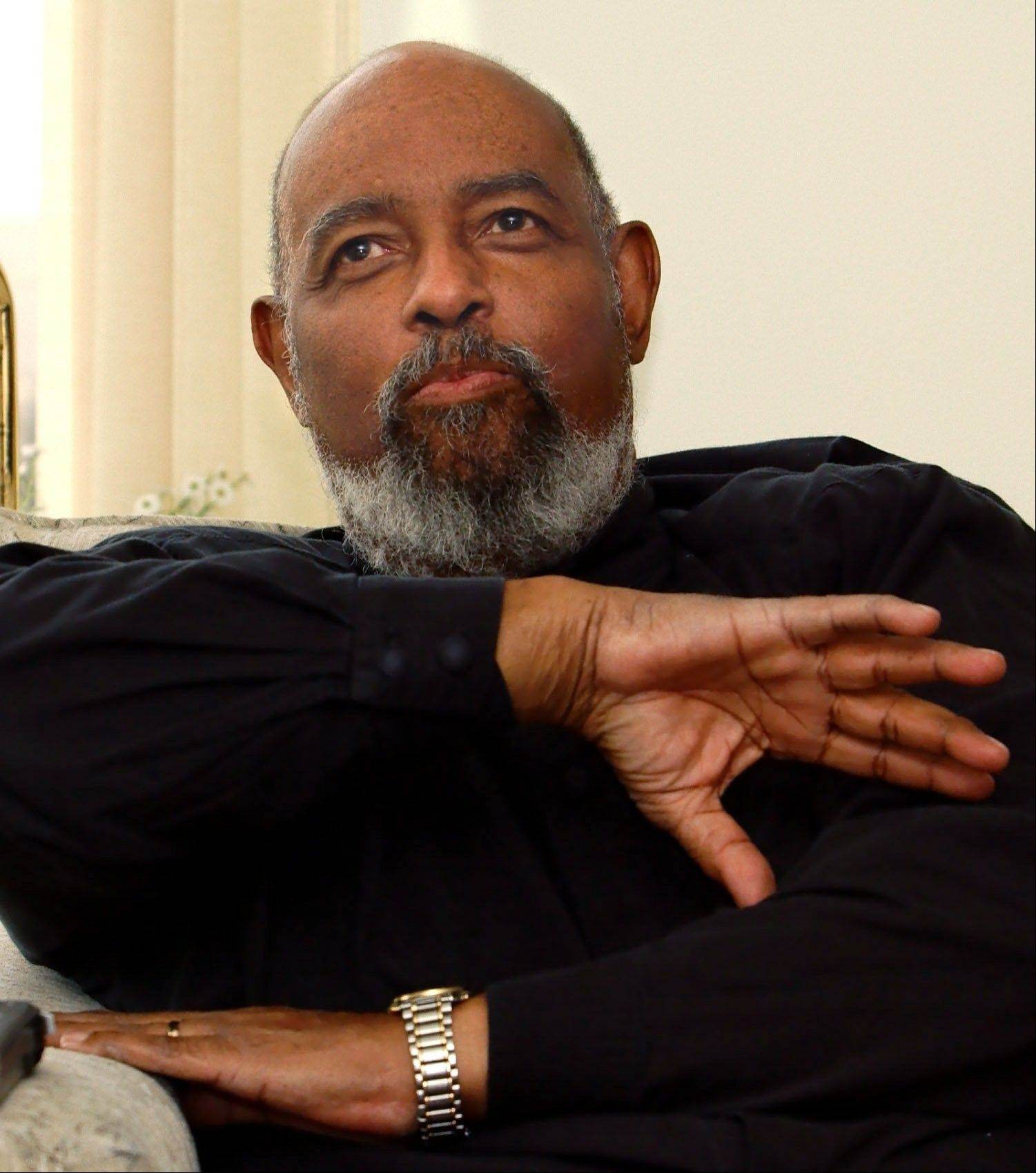 In this May 9, 2002, file photo, James DePreist, talks about his conducting career as he sits in his high rise apartment overlooking downtown Portland. One of the early African-American conductors of a major orchestra and National Medal of Arts winner James DePreist has died at age 76. His manager, Jason Bagdade, says DePreist died at home Friday, Feb. 8. 2013, in Scottsdale, Ariz.