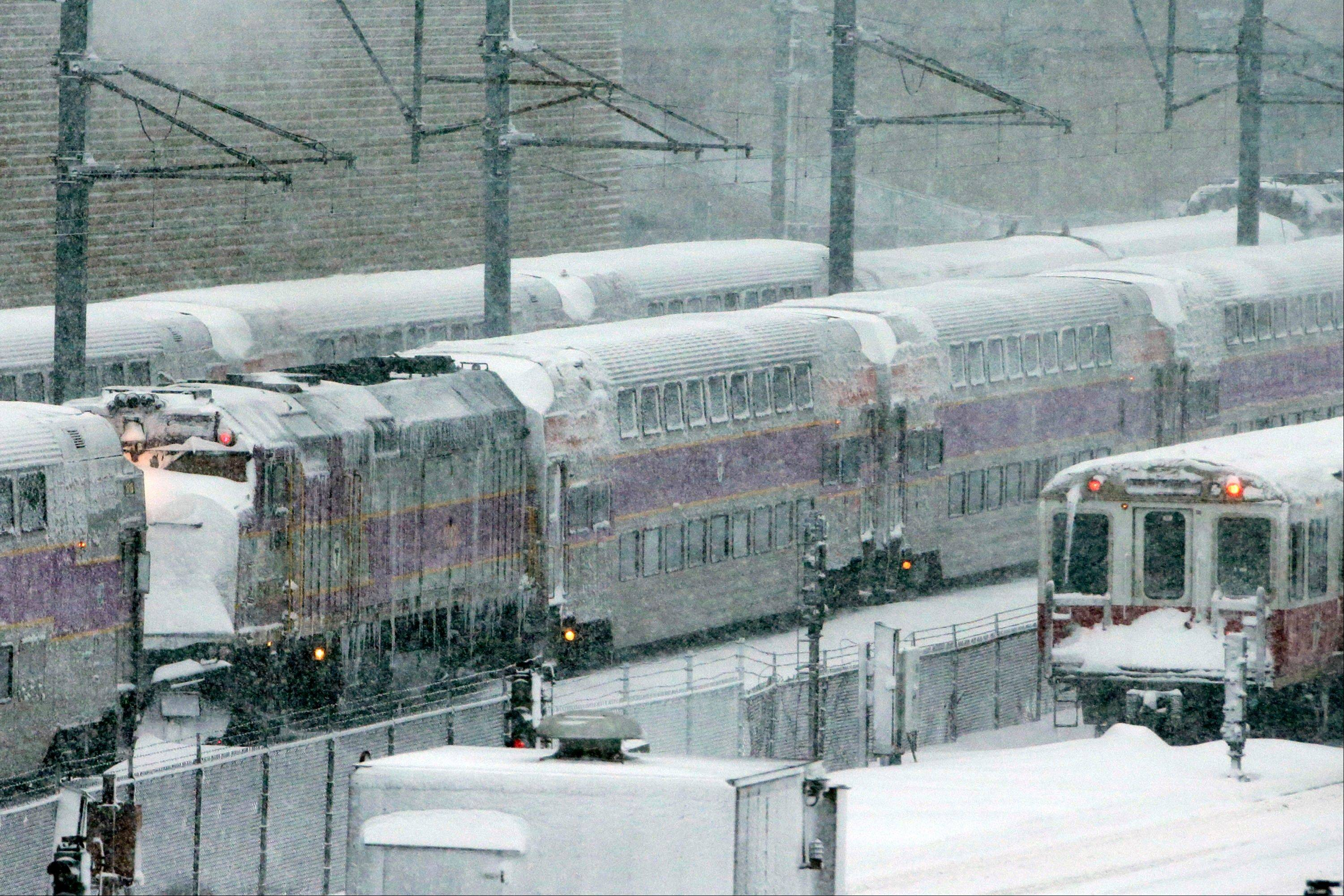 Massachusetts Bay Transportation Authority trains sit idle early Saturday in Boston due to high winds and the nearly two feet of snow that fell in the area overnight.