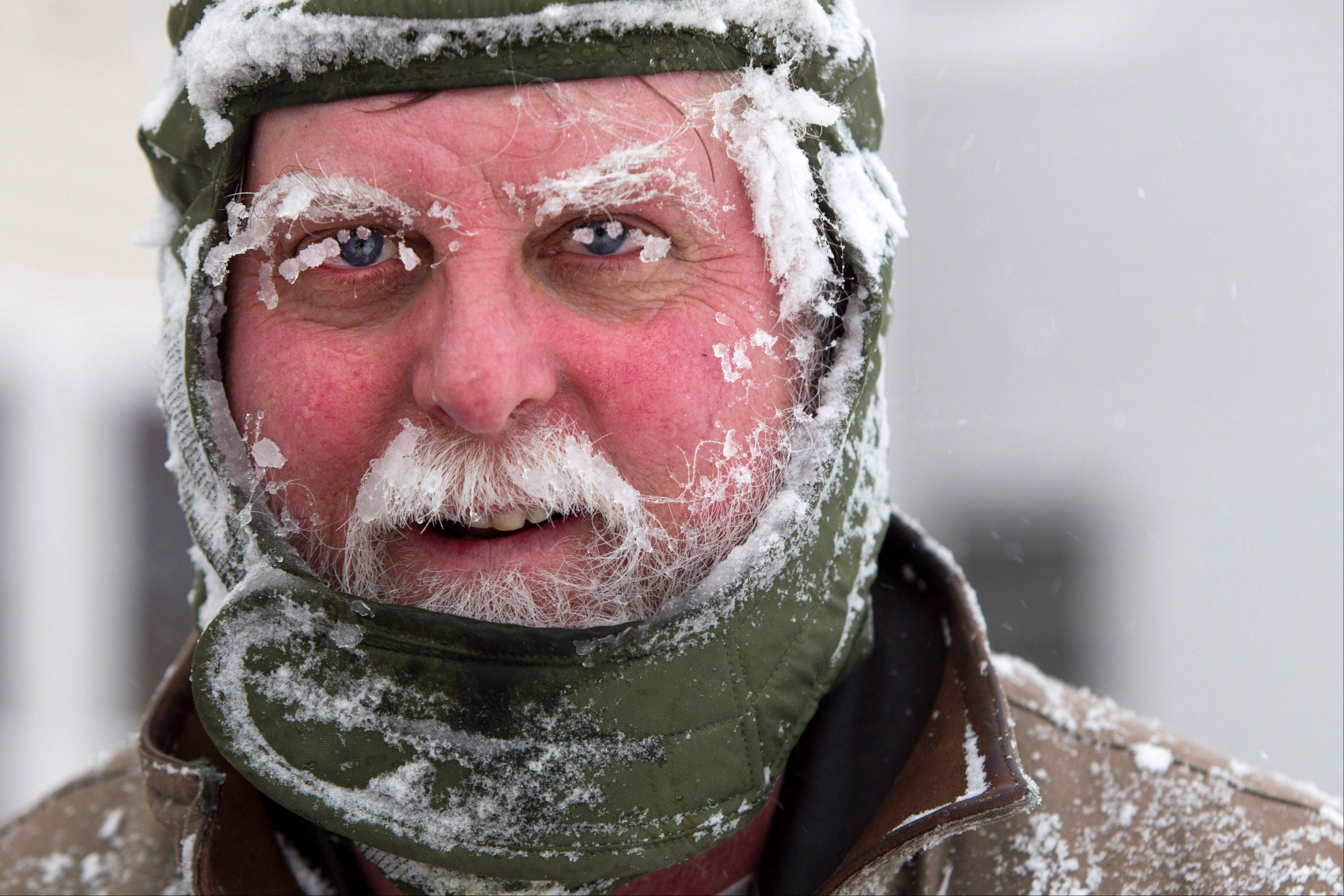Ice clings to Ken Anderson's eyebrows and mustache as he uses a snowblower during a blizzard, Saturday, Feb. 9, 2013, in Portland, Maine. The storm dumped more than 30 inches of snow as of Saturday afternoon, breaking the record for the biggest storm on record.