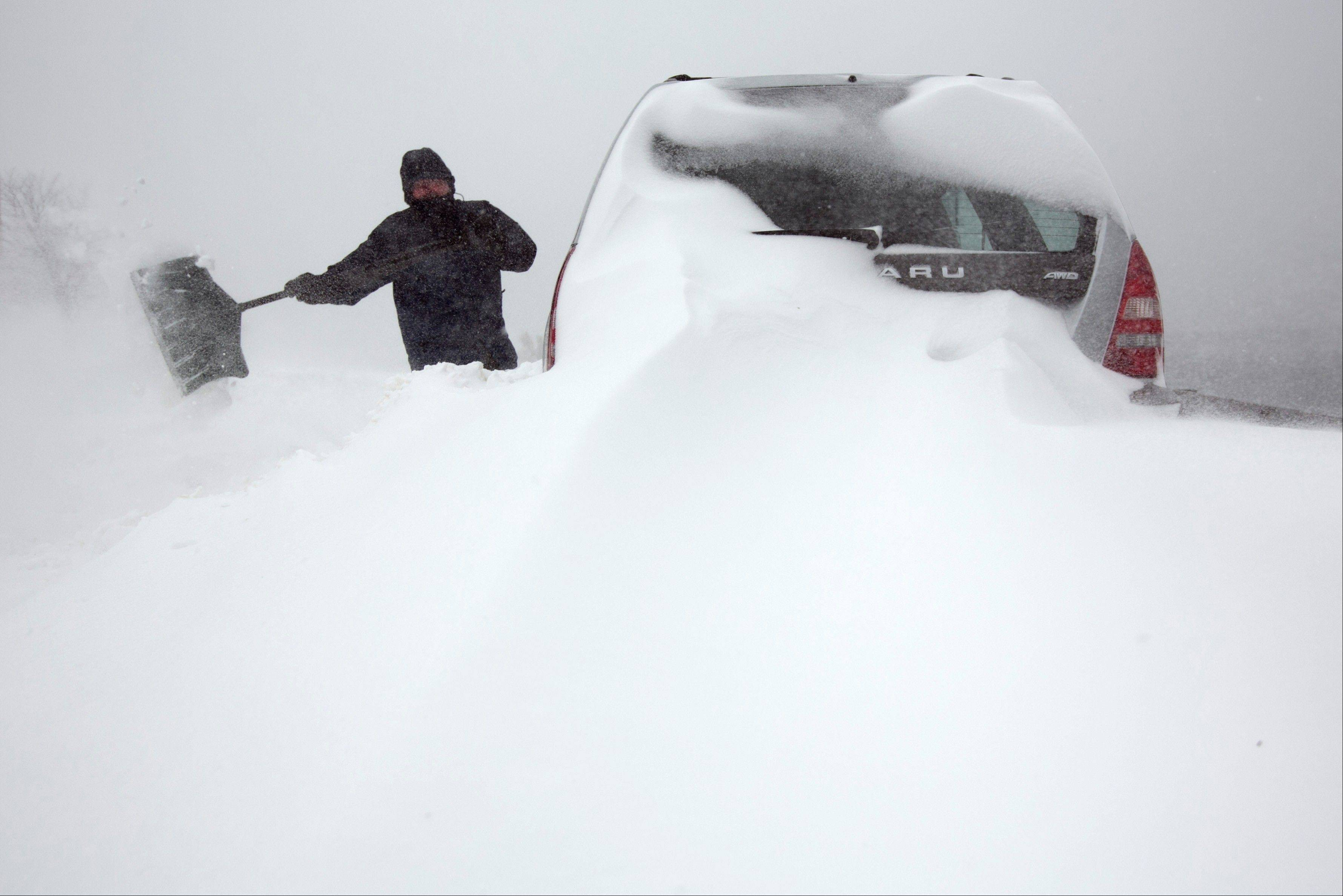 Steve Hull digs out his car after it was covered by drifting snow in Portland, Maine on Saturday, Feb. 9, 2013. A behemoth storm packing hurricane-force wind gusts and blizzard conditions swept through the Northeast overnight.