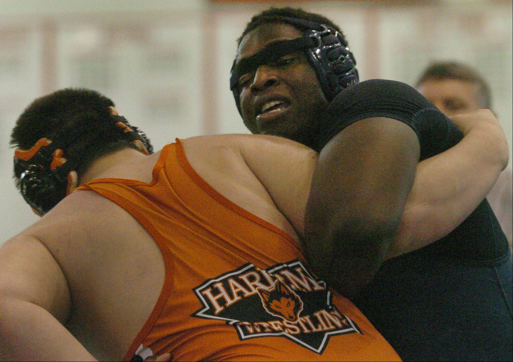 Shola George of Prospect, right, wrestles Jared Carlton of Harlem at 285 pounds during sectional wrestling at Barrington.