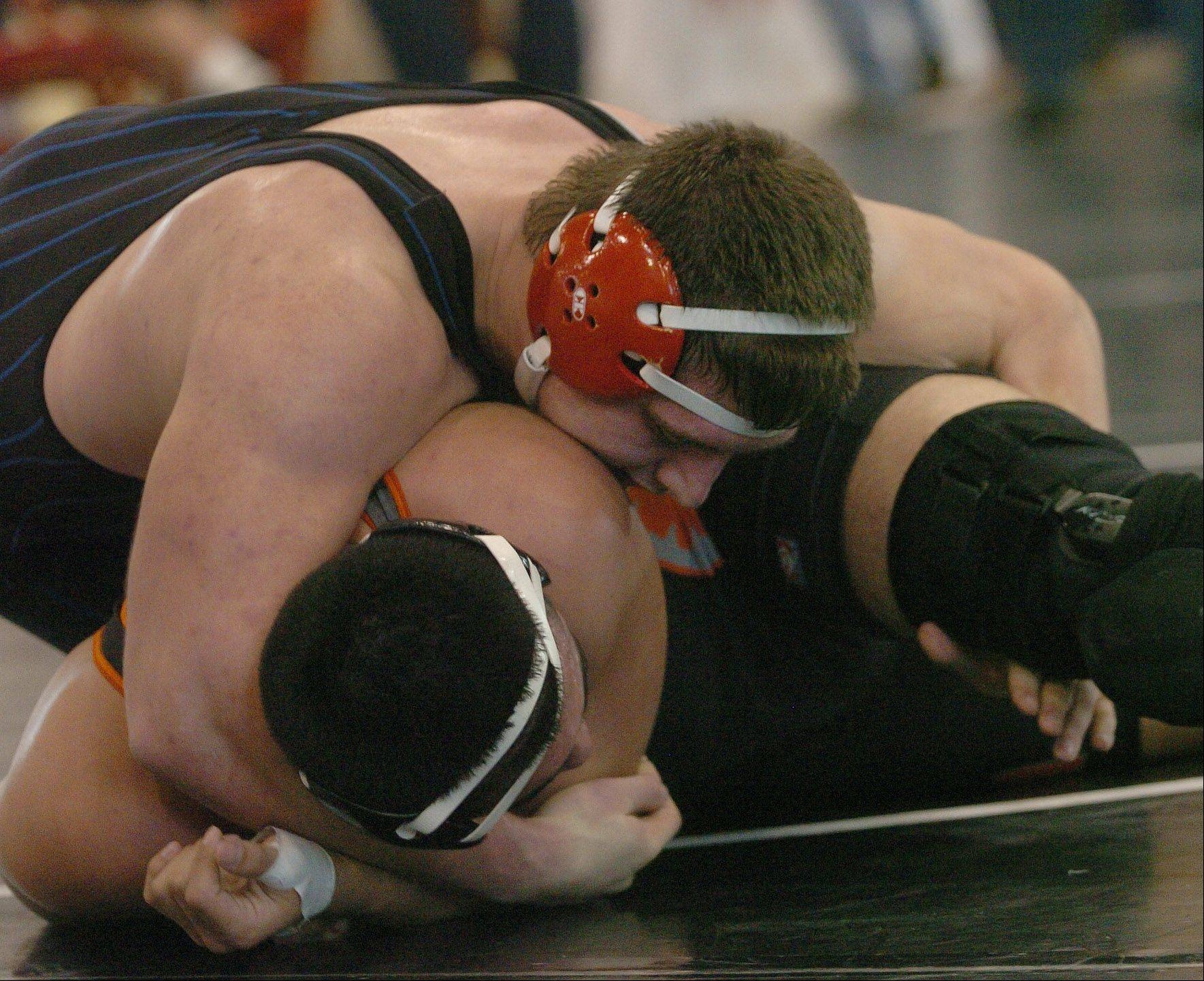 Ray Griggle of Dundee-Crown, top, wrestles Luis Hernandez of McHenry Saturday at Barrington.