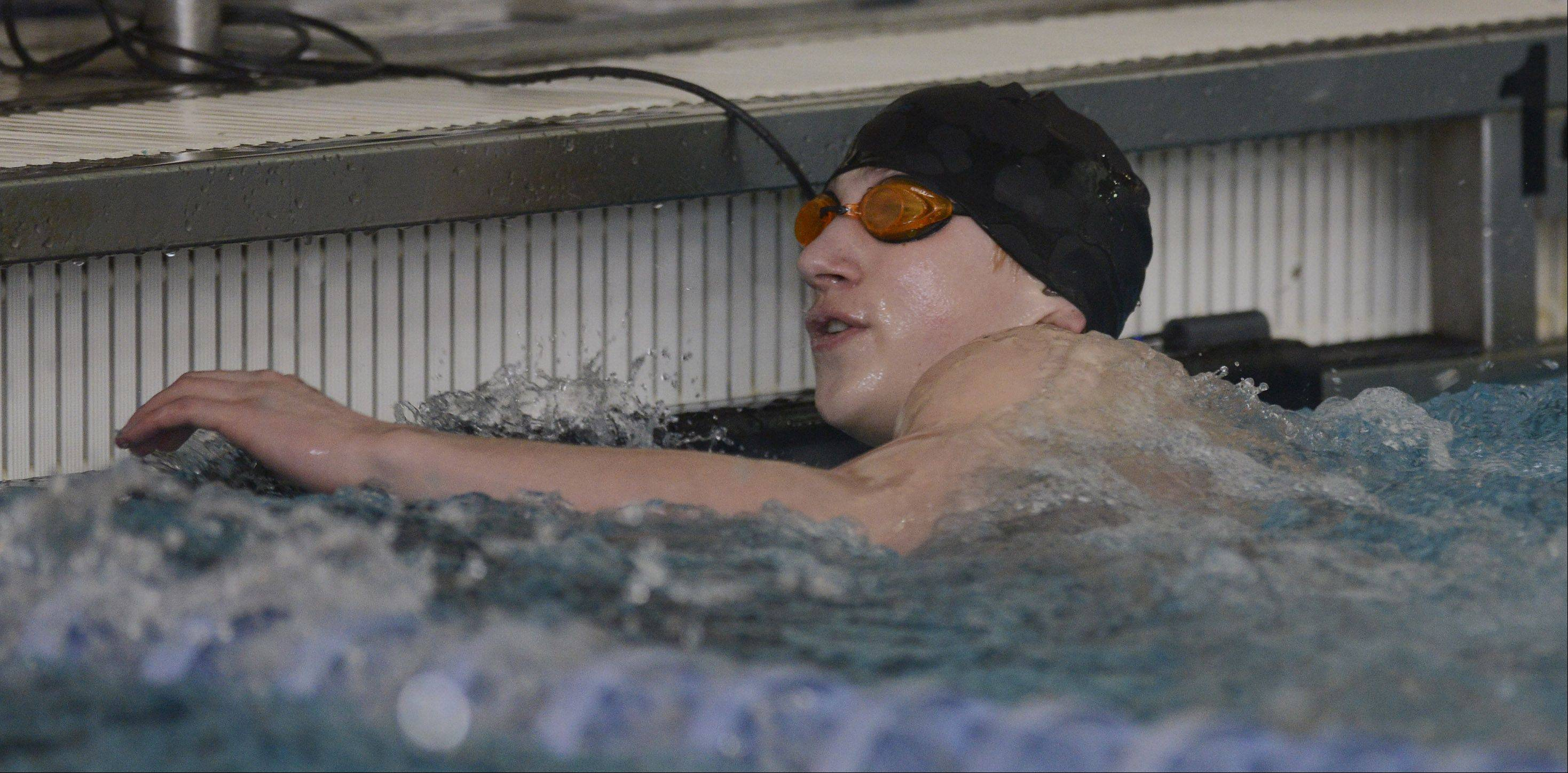 Connor Black of Mundelein checks his time after the 50-yard freestyle during the North Suburban Conference boys swim meet at Lake Forest High School on Saturday.