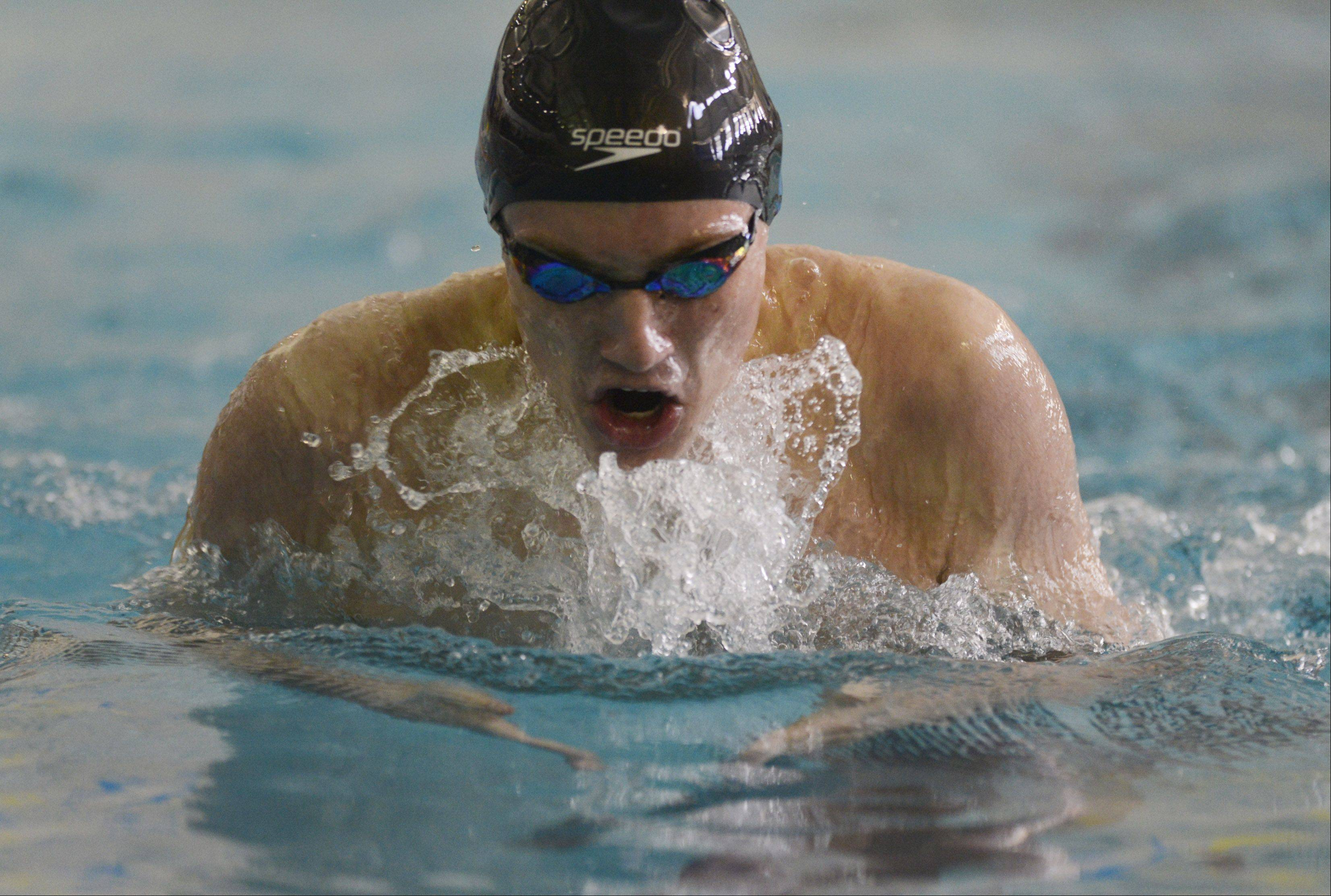 Warren's Matt Conway swims the breaststroke portion of the 200-yard individual medley during the North Suburban Conference boys swim meet at Lake Forest High School on Saturday.