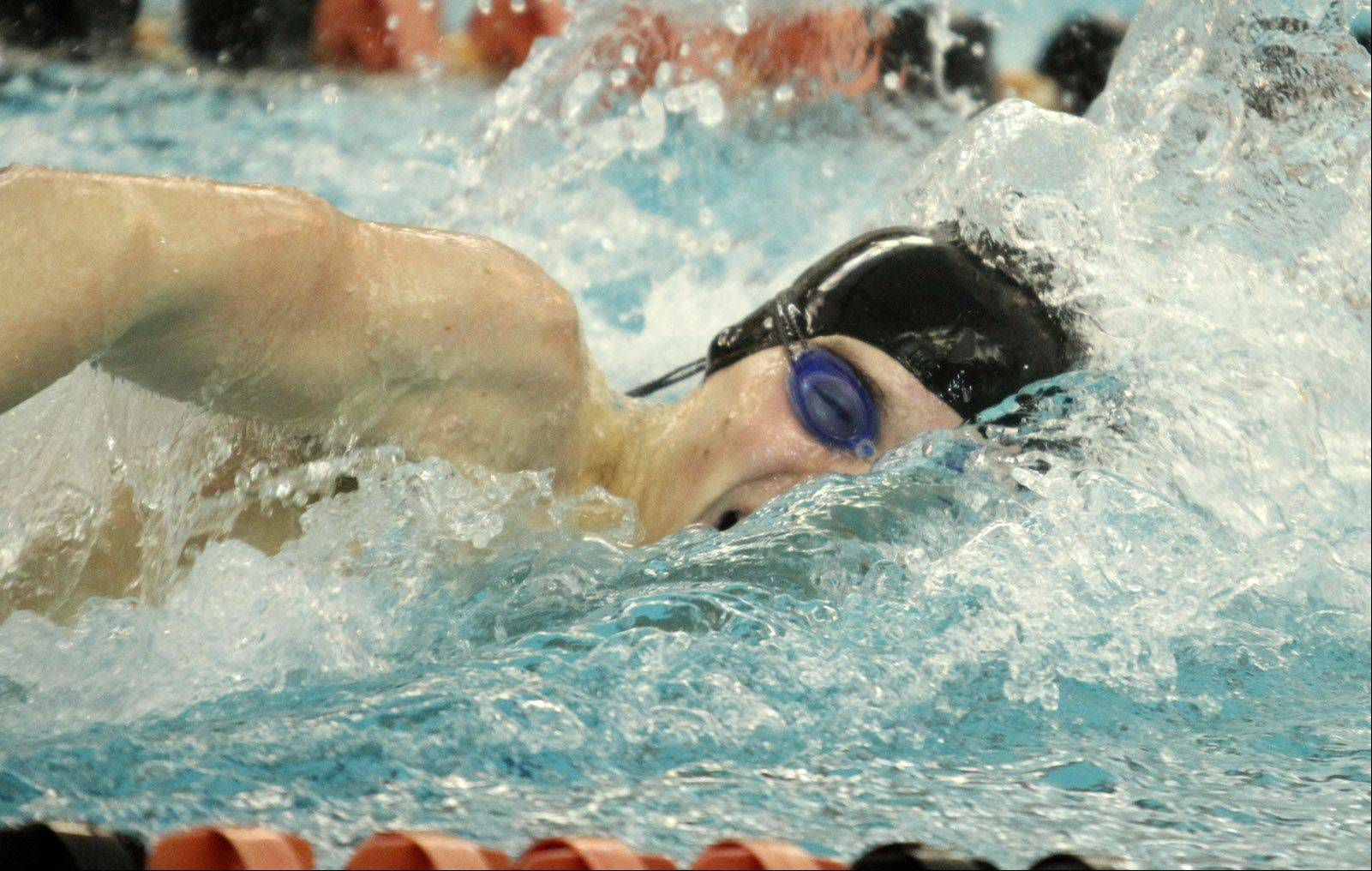 Conant's Jonathon Burke heads for a victory in the 200-yard freestyle at the Mid-Suburban League meet at Barrington on Saturday.