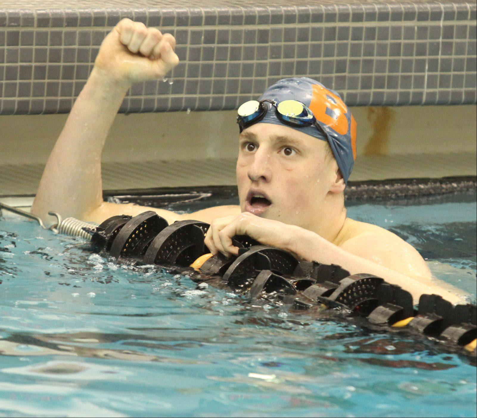 Buffalo Grove's Matt Schulstad wins the 200-yard individual medley at the Mid-Suburban League meet at Barrington on Saturday.