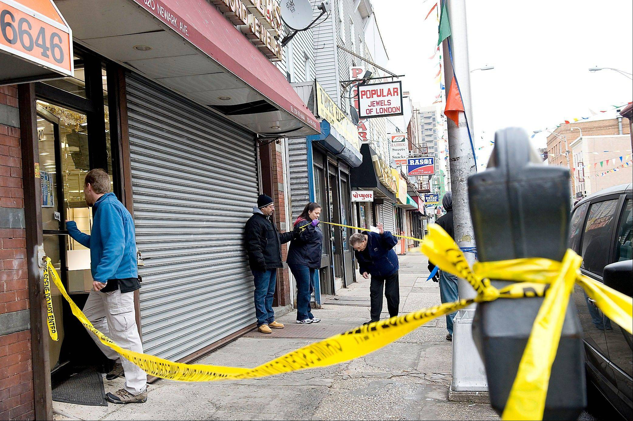 FBI agents enter Raja Jewelers in Jersey City last week, investigating an international credit card fraud ring. The $200 million credit card scheme authorities broke up was notable not only for the amount of money involved, but the outlay of patience and planning it required.