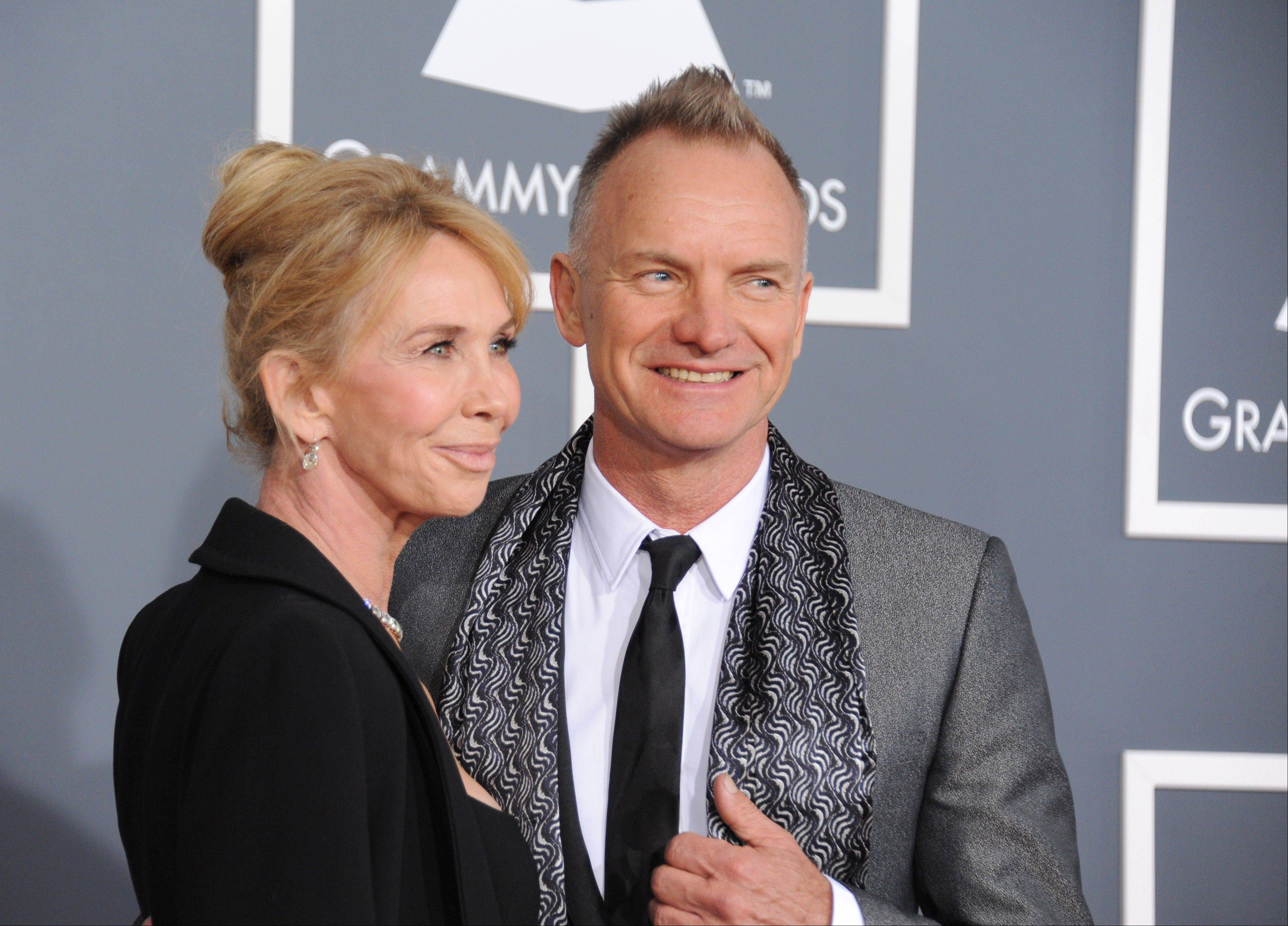 Trudie Styler, left, and musician Sting arrive at the 55th annual Grammy Awards on Sunday, Feb. 10, 2013, in Los Angeles.